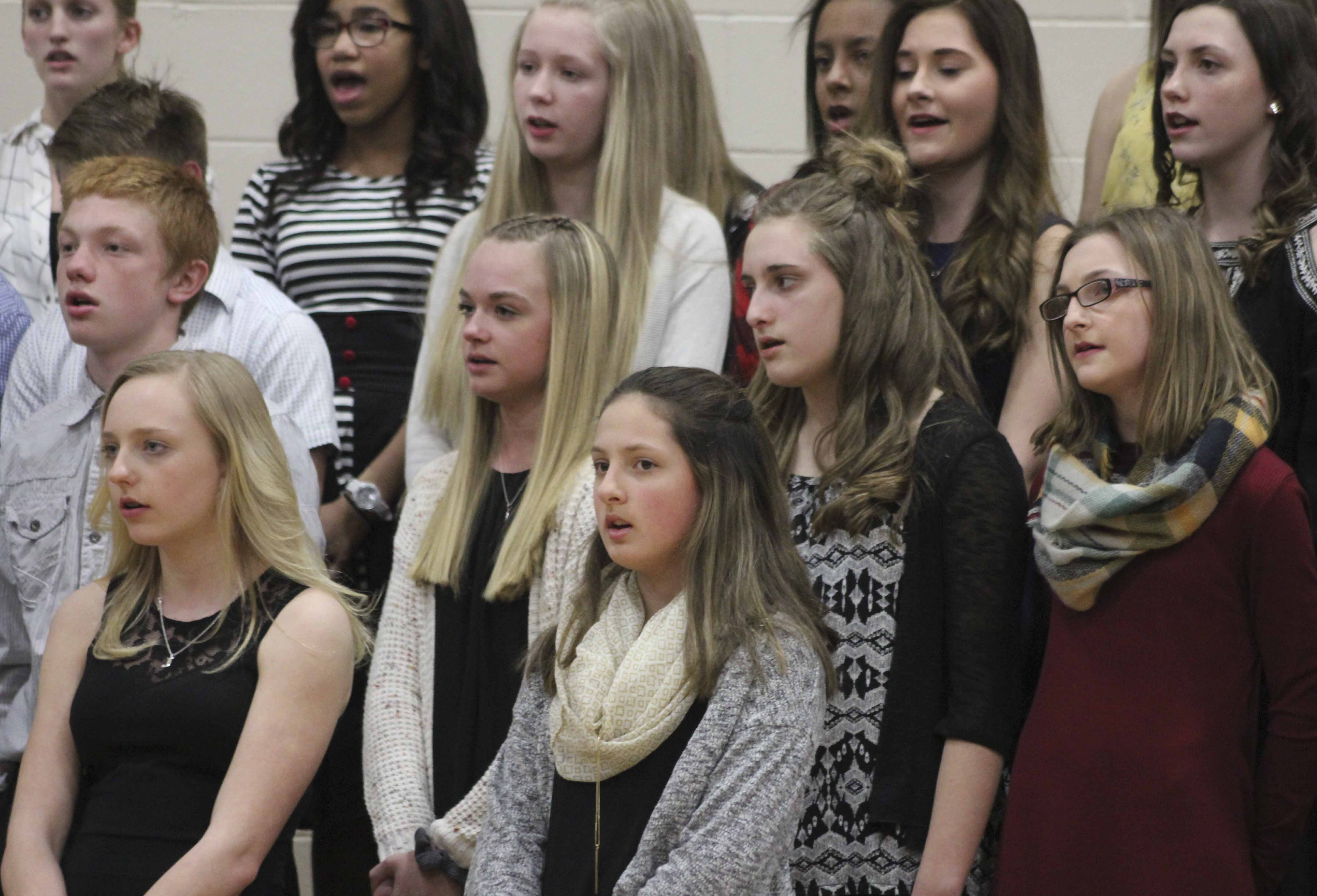 Middle school girls sing in the All-Vocal concert. Among them are, first row from left: Jordan Norton and Alijah Parrish. Second row: Brendan Koppes, Kelsey Adams, Kayla Simmons and Gracie Henderson.