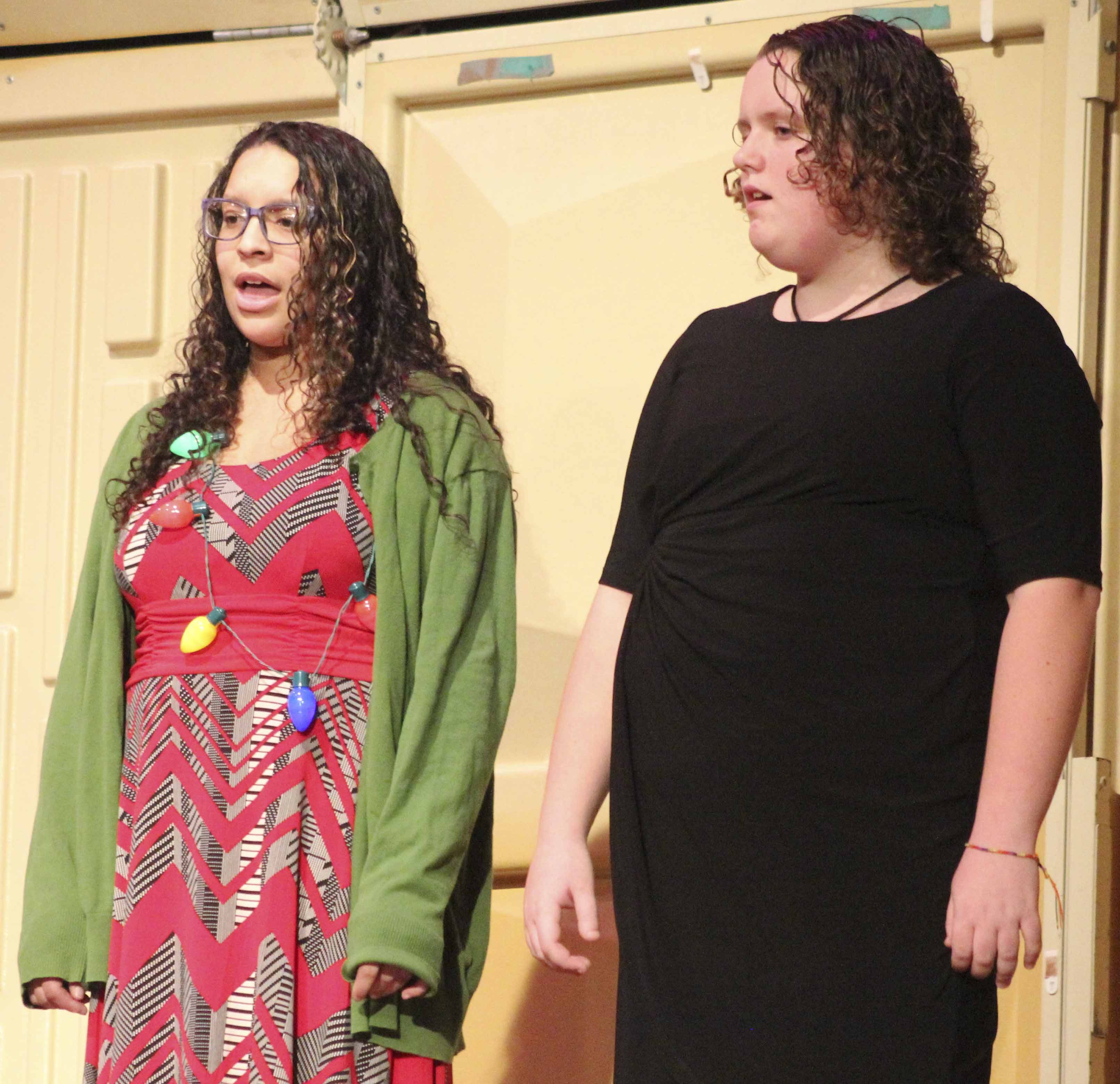 Yasmin Al-Ansar Arnold (left) and Becky Lang were among OPUS auditioners performing at the middle school concert.