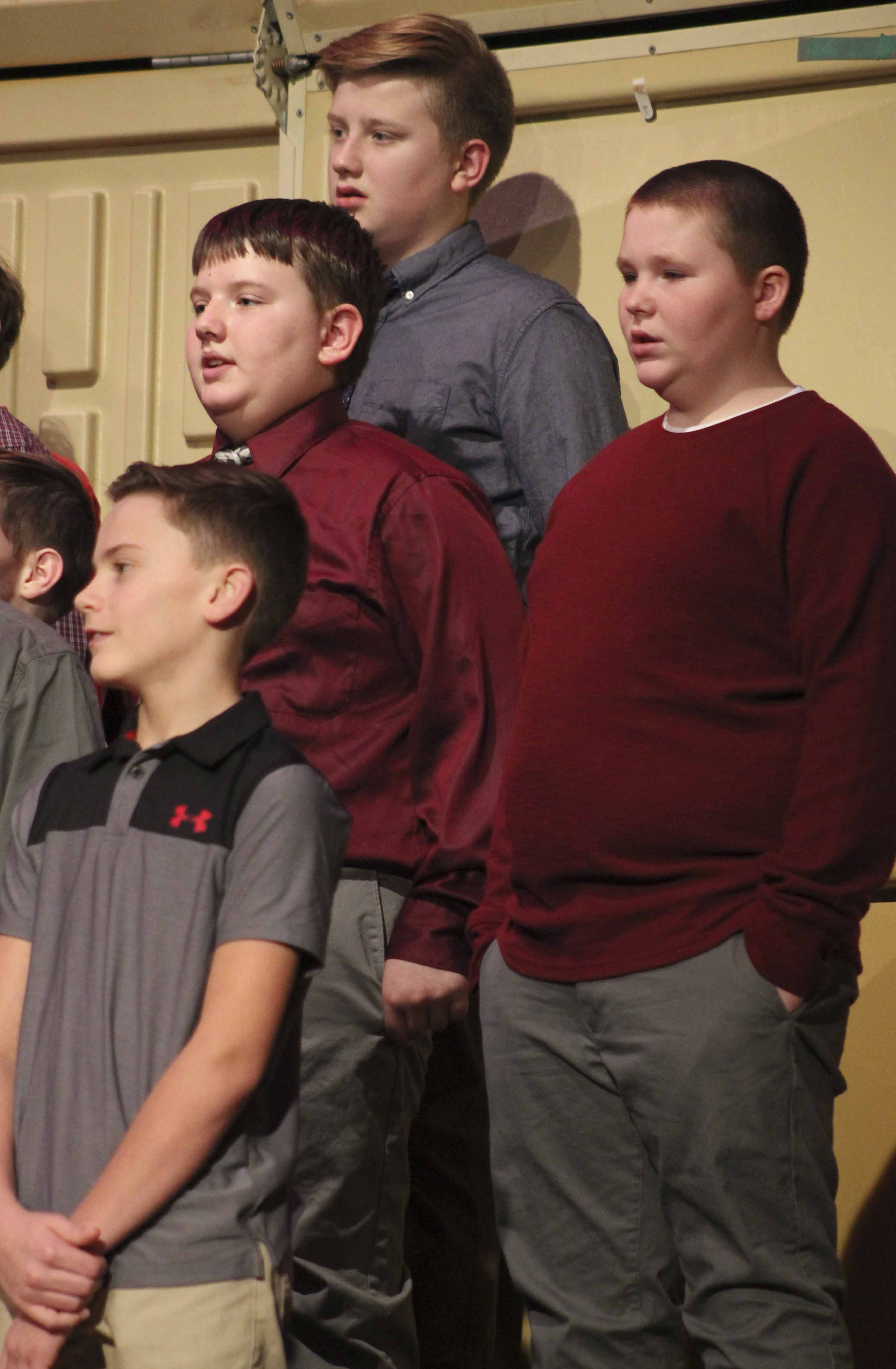 Singing in the seventh-grade portion of the concert, first row: Peyton Schilling. Second row from left: Malcolm Clark and Brady Hayen. Third row: Peyton Speltz.