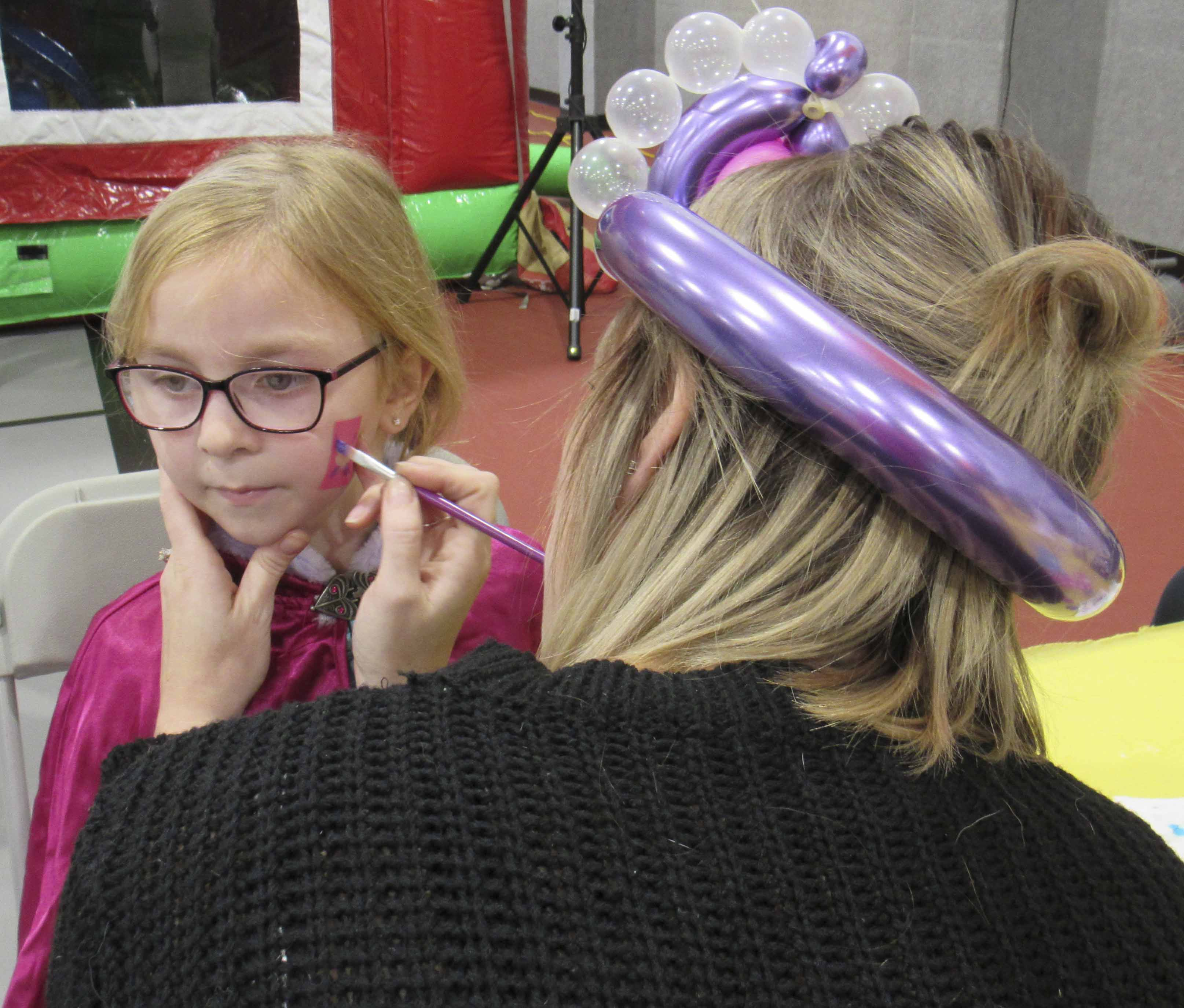 Austin's Halloween Fun Night featured bounces houses, food, balloon animals, and family-friendly entertainment. Blakeleigh Light of Anamosa also got her face painted.