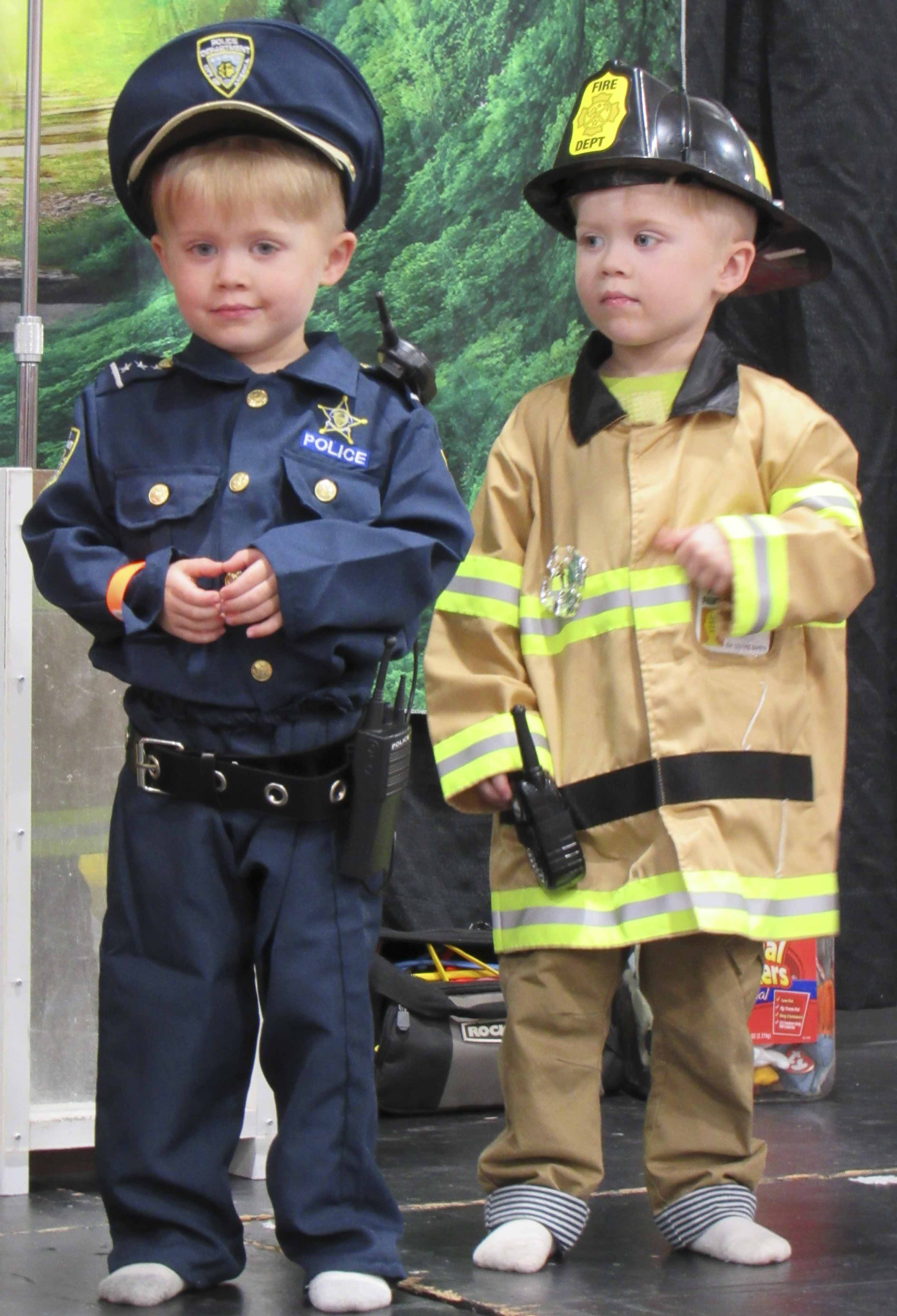 Brothers Mason and Noah Brus of Martelle showed their support for public officials, dressed as a police officer and firefighter.