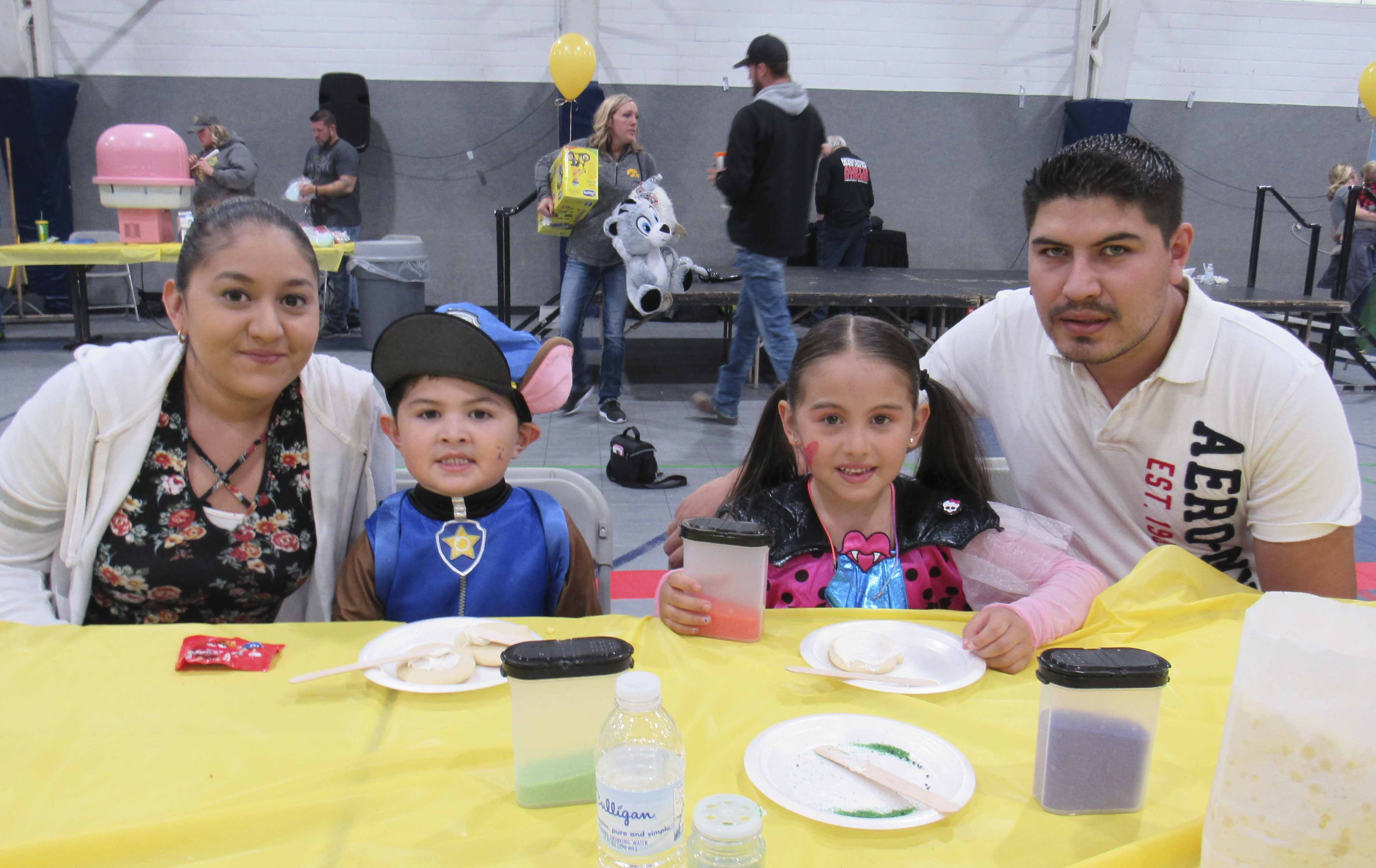 The Second Annual Austin's Halloween Fun Day to Scare Away Childhood Cancer included numerous activities for kids of all ages and families. The event honors Austin Smith who passed away in 2016 from cancer. Austin's birthday is also Oct. 28. The Fernandez family took part in cookie decorating. From left are Celene, Fermin Jr., Cynthia, and Fermin.