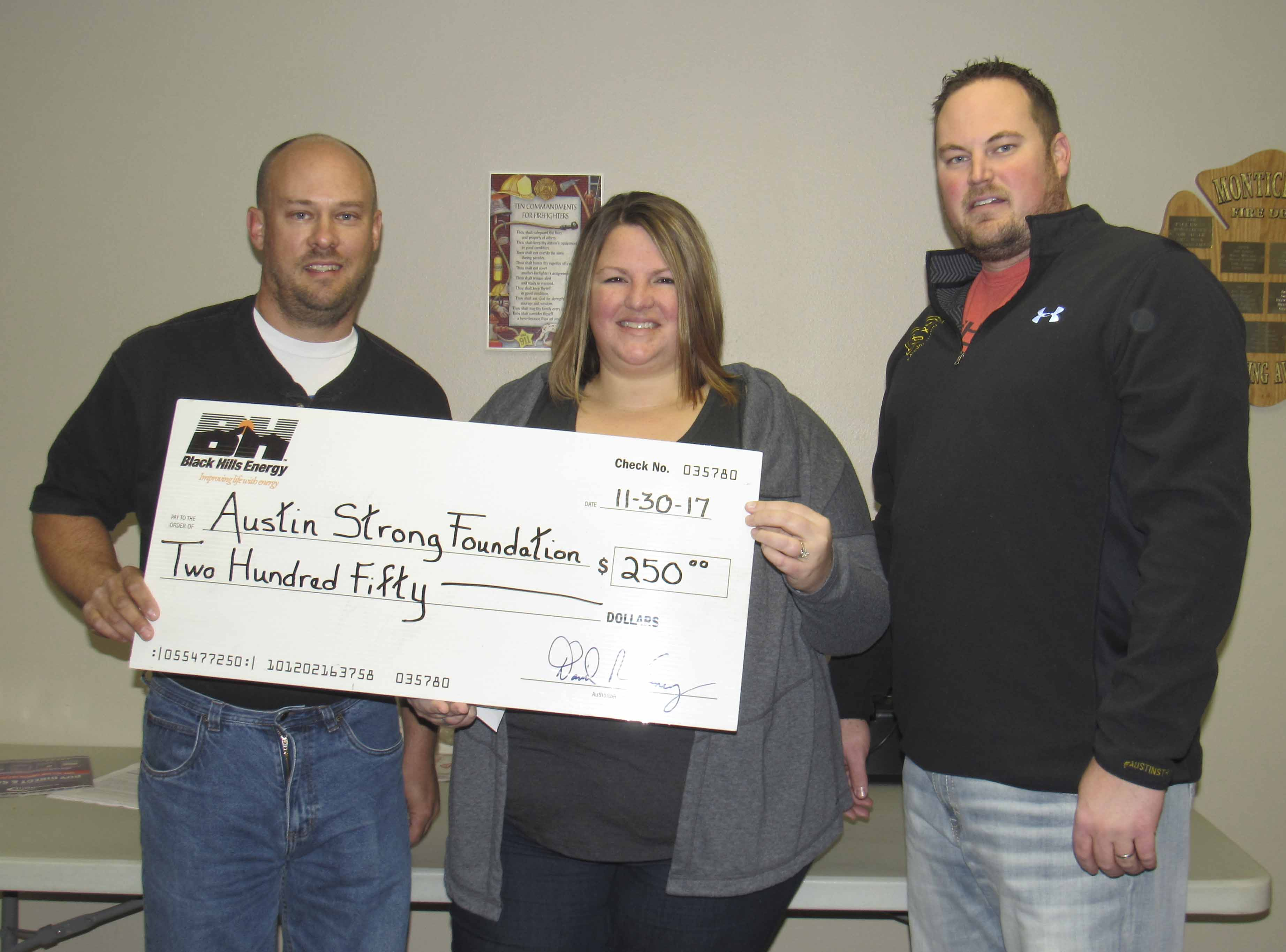 Black Hills Energy Service tech Brian Kearney selected the Austin Strong Foundation as the recipient of a $250 donation. The Foundation was created in Austin Smith's name to help fight childhood cancer. From left are Kearney and Austin's parents Mikinzie and Britt Smith. (Photo by Kim Brooks)