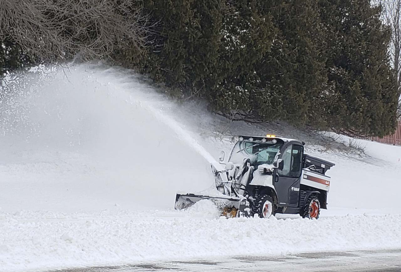 Monticello Parks and Recreation Director Jacob Oswald clears snow from Willow Trail along Oak Street in Monticello Dec. 30. The first major snowstorm of the season, Dec. 29, dropped about 10 inches on the city. (Photo by Pete Temple)