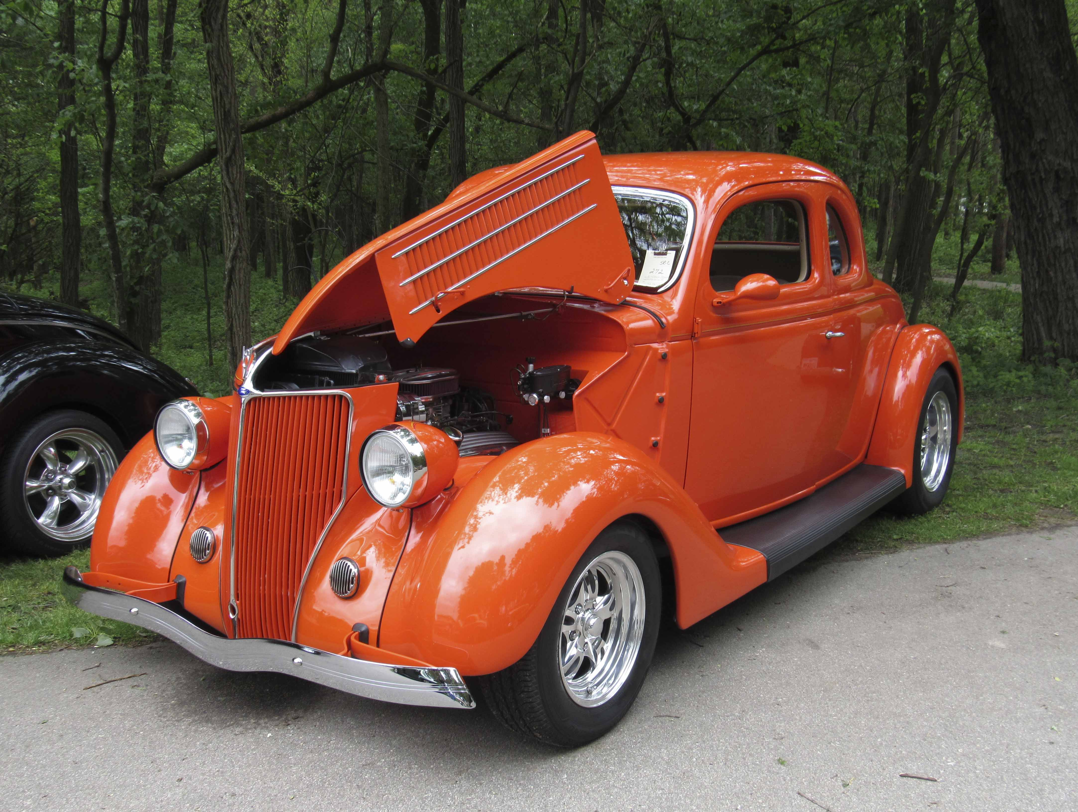 This bright orange 1936 Ford Coupe belongs to Al and Rhonda Pearce of Washburn, Iowa. This was just one of the hundreds and hundreds or cars on display at the Camp Courageous car show.