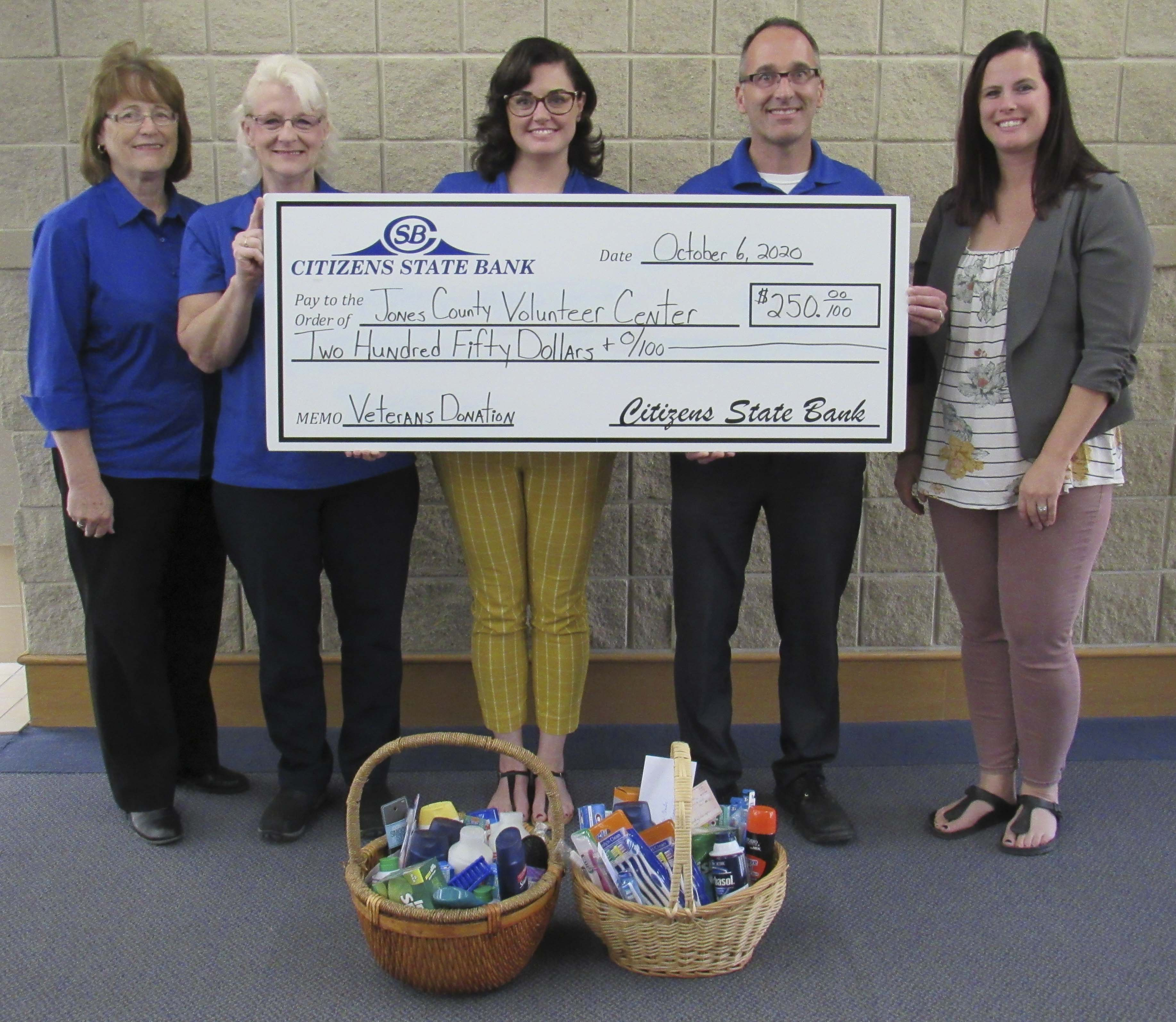 Citizens State Bank in Monticello donated $250 and personal hygiene items to the Jones County Volunteer Center's annual Personal Supply Drive. The event honors 9/11 and Patriot Day. From left are CSB employees Audrey Savage, Karla Kelley, Staci Klocke, Dave Sunlin, and Volunteer Center Director Amy Keltner. (Photo by Kim Brooks)