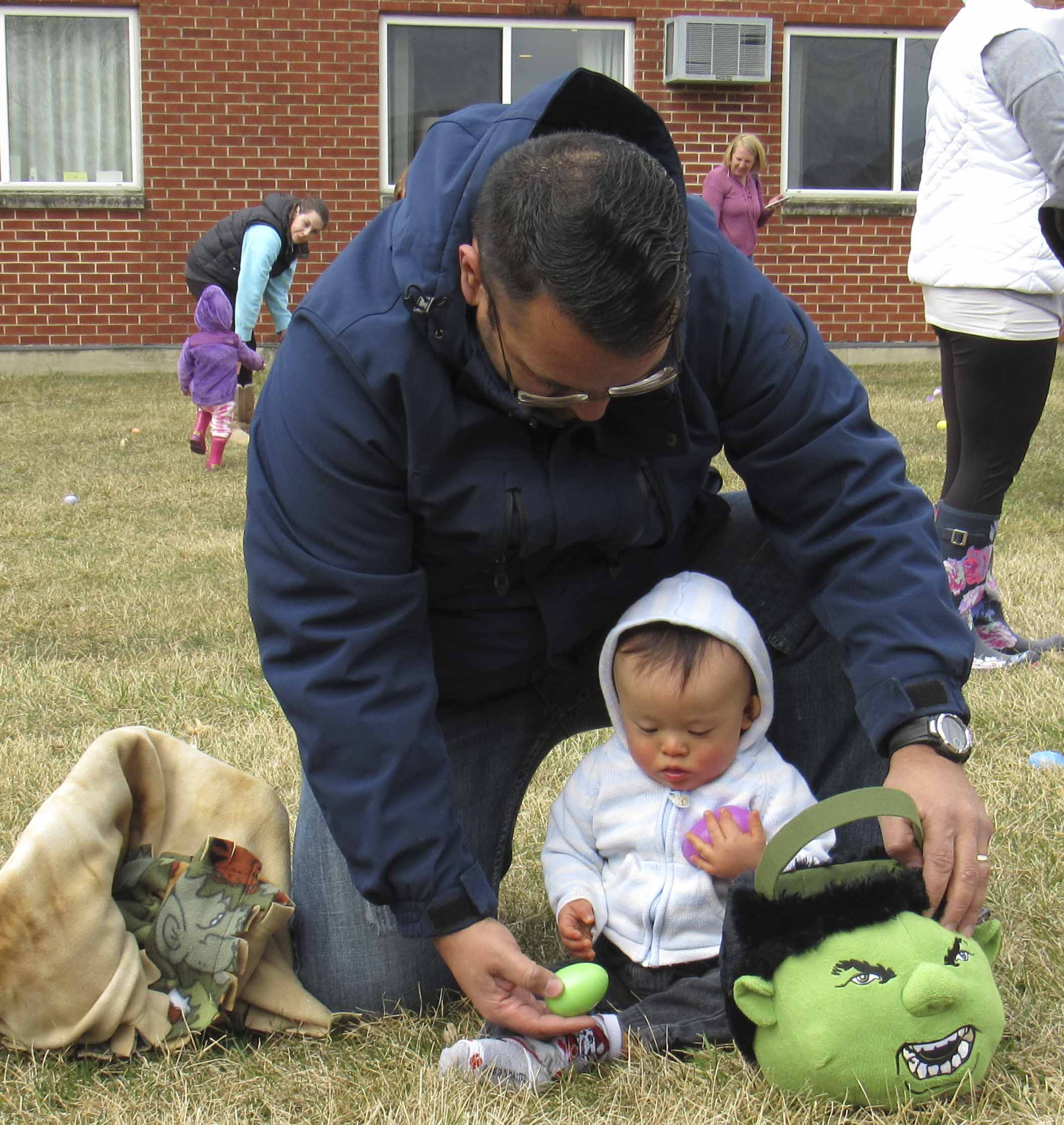 Rolondo Morales helps his son Alan during the Easter egg hunt, March 31, at Monticello Nursing and Rehab Center. (Photos by Kim Brooks)