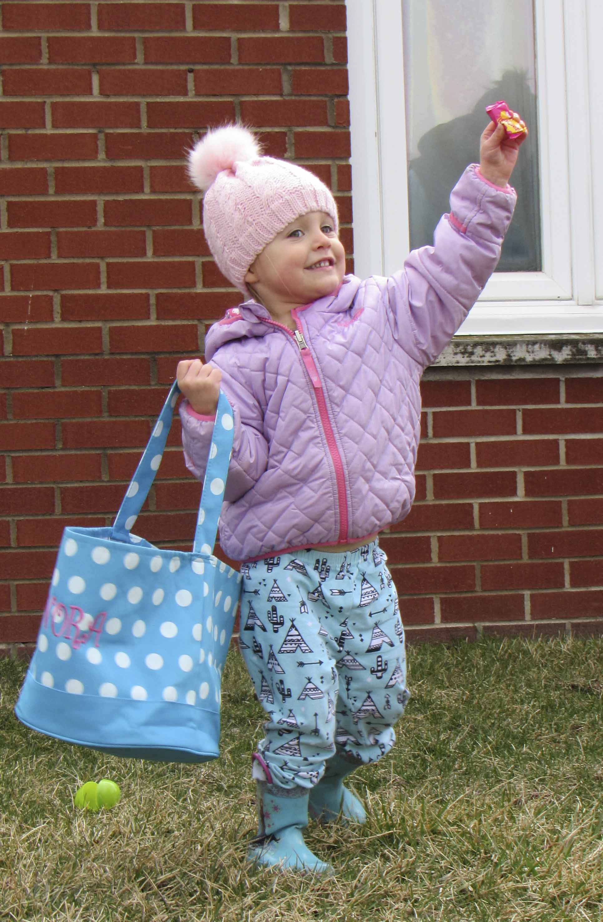 Nora Harms shows her excitement at finding a piece of candy during the Easter egg hunt over the weekend.