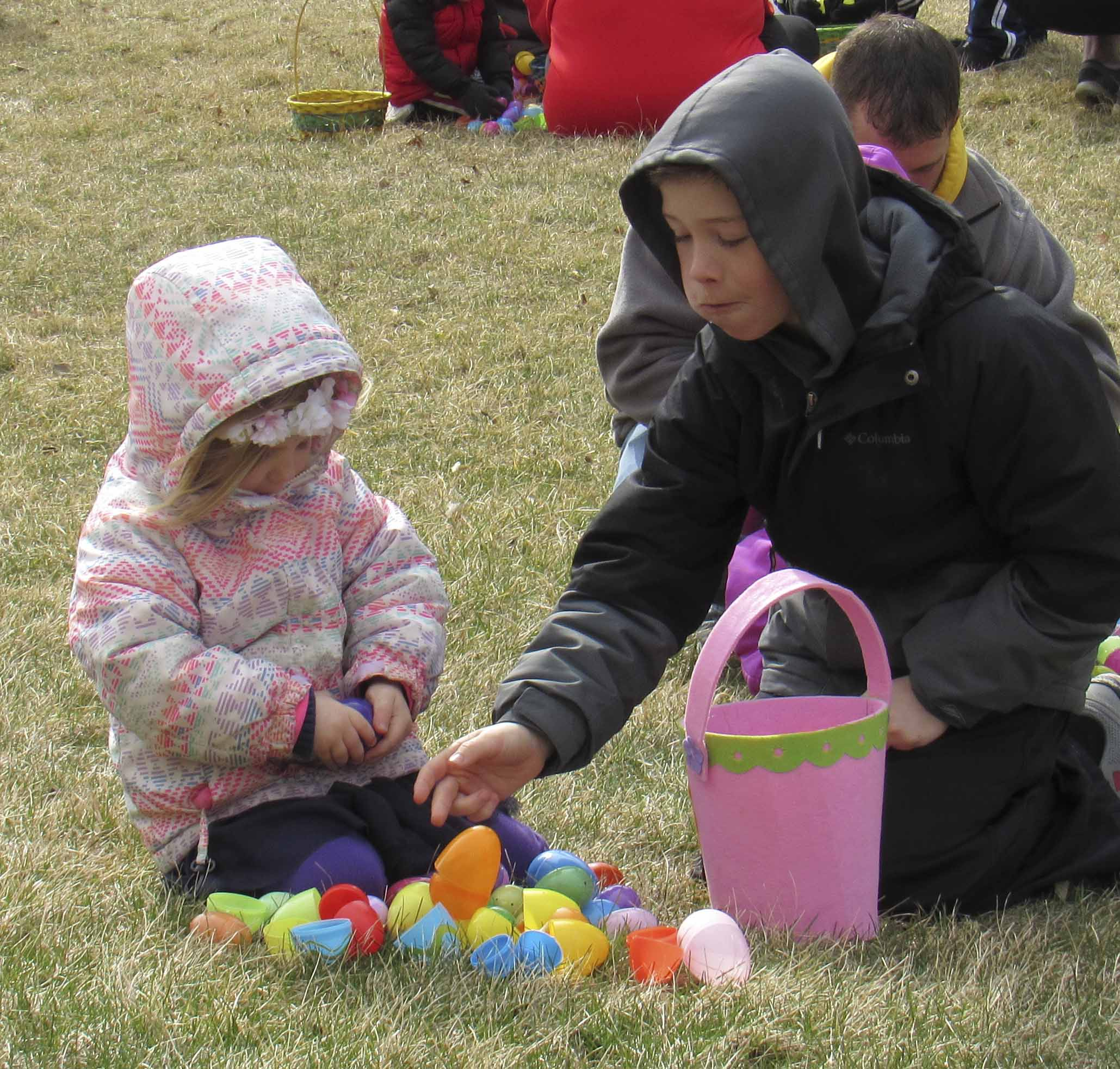 Brody Martin eats a piece of candy as he assists his younger sister Maci open all of her Easter eggs. Monticello Nursing and Rehab Center sponsored the egg hunt.