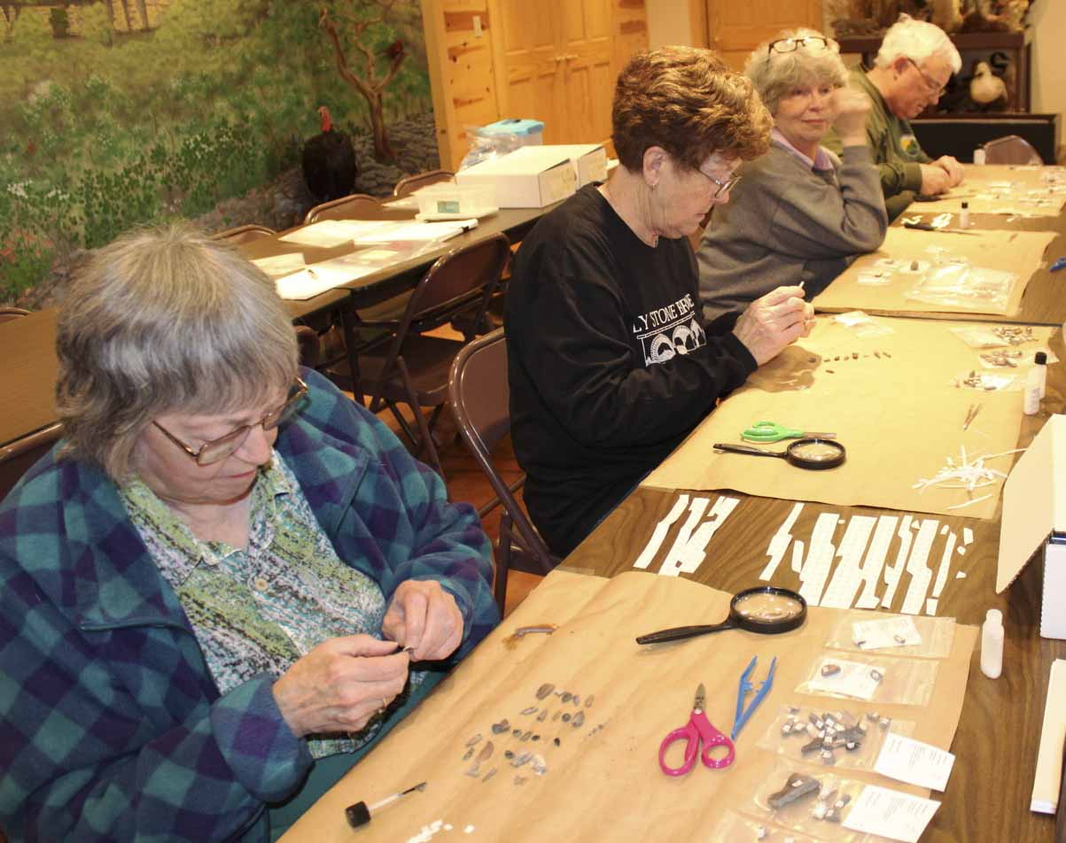 Volunteers visited the Central Park Nature Center on April 4 to help label artifacts that were found in 2013 at the Eby's Mill Wildlife Area. From left are Joy Adams, Alice Shimanek, and Sandy and Bill Edwards. A total of 15 people volunteered for the labeling exercise. Archaeologists Bryan Kendall and Bill Moore were also on hand to guide the volunteers in the labeling process. (Photos courtesy of Michele Olson)
