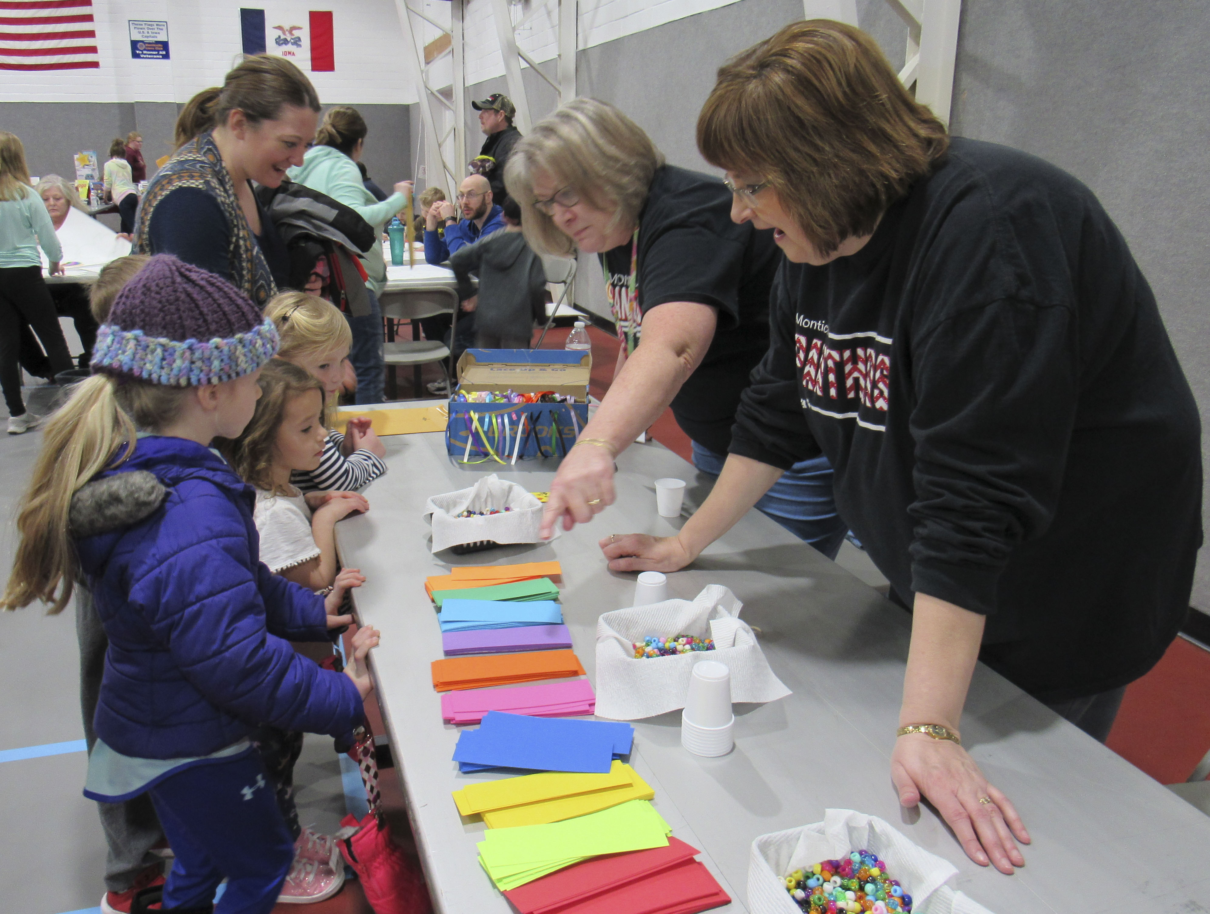 Carpenter Elementary Secretary Cindy Plumber and fourth-grade teacher Angie Wink pass out supplies for making bookmarks during Family Night on March 12. Parents and students of all ages took part in the evening event that was sponsored by the elementary PBIS team. There were several family crafts and learning activities for all ages. (Photos by Kim Brooks)