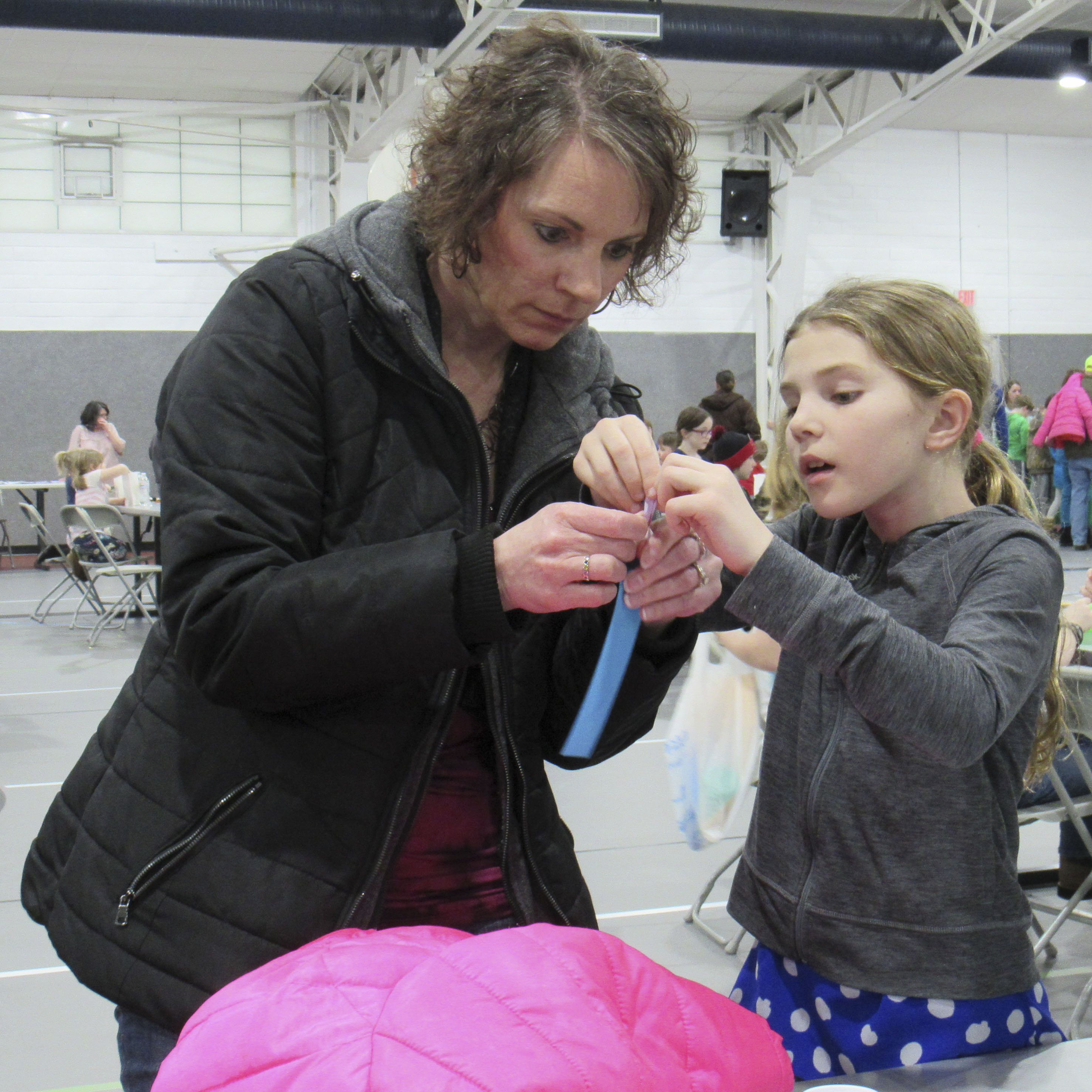 Mother and daughter Kellie and Kayla Arduser, second grade, work together on a craft project during Monticello Elementary Family Night.