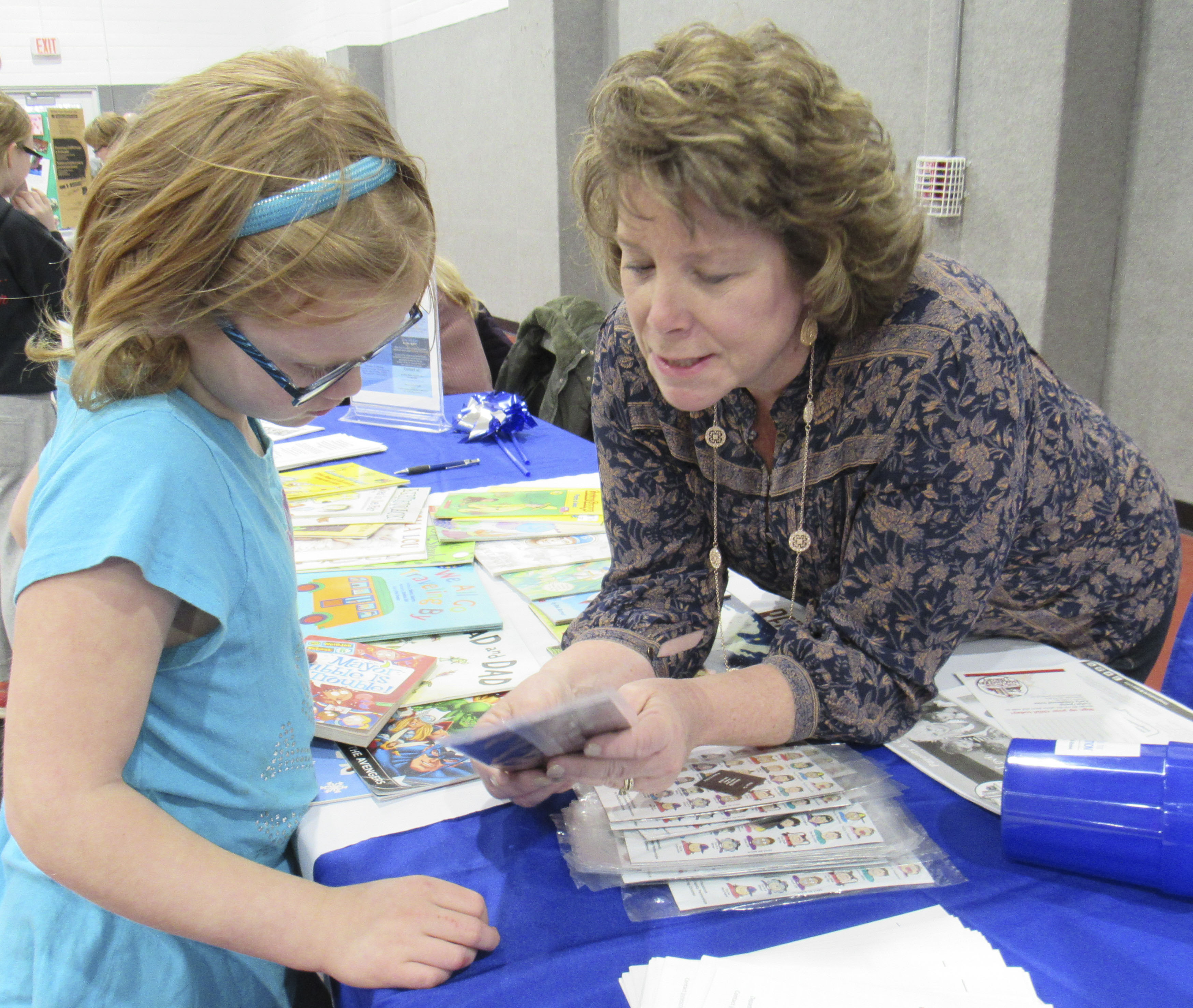 Monticello Family Night also included several educational vendors. Sherri Hunt with Early Childhood Iowa Cedar/Jones and Jones County Community Partnerships for Protecting Children handed out free books and stickers to children, including Bianca Lovell, fourth grade.