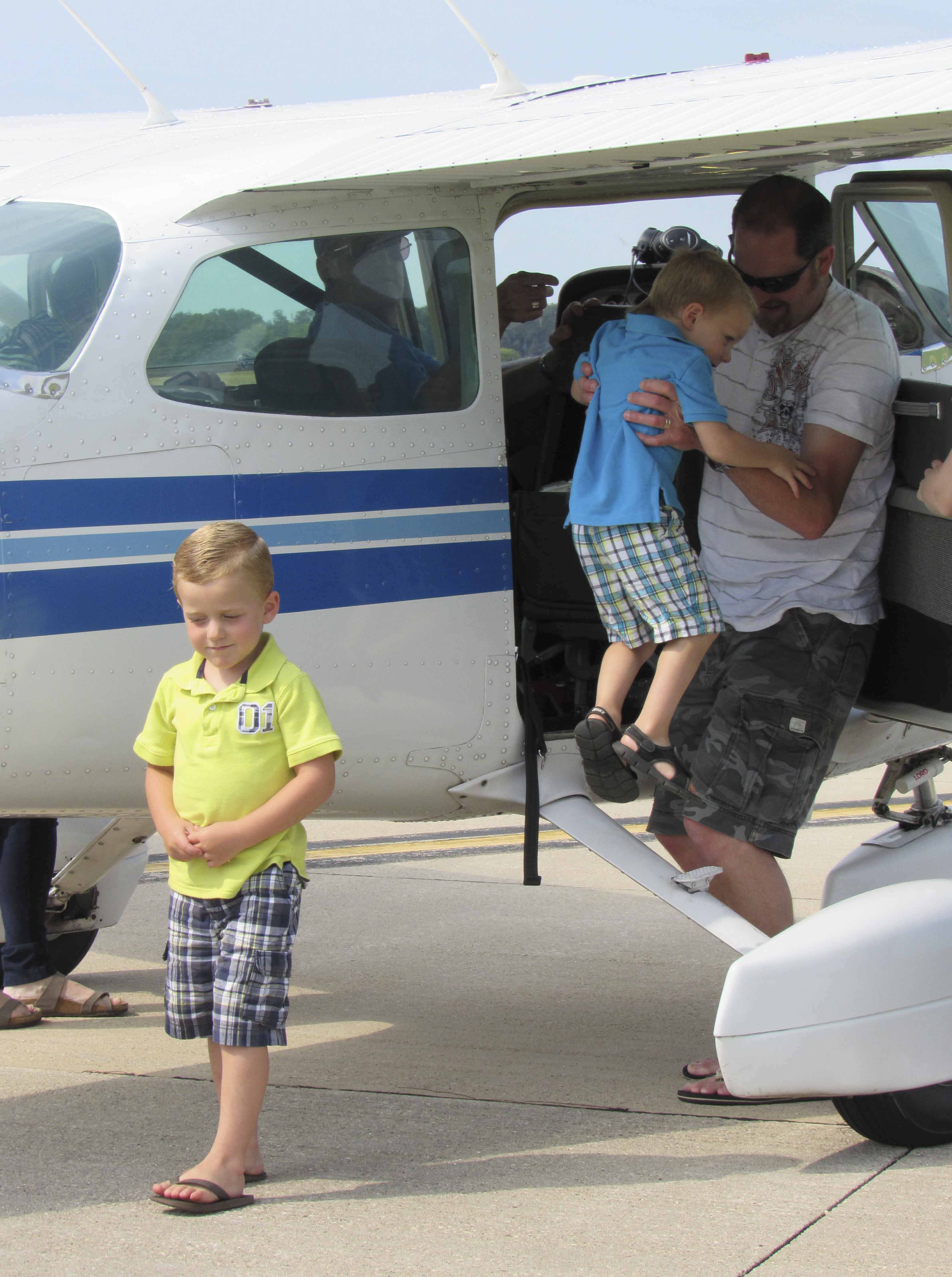 Tom Flannery helps his sons Keiran and Nyles out of a plane after a 30-minute ride. Several families enjoyed plane rides during the Fly-in Breakfast. The Flannery family from Alburnett spent the morning at the Monticello airport. Keiran aspires to be a pilot some day.