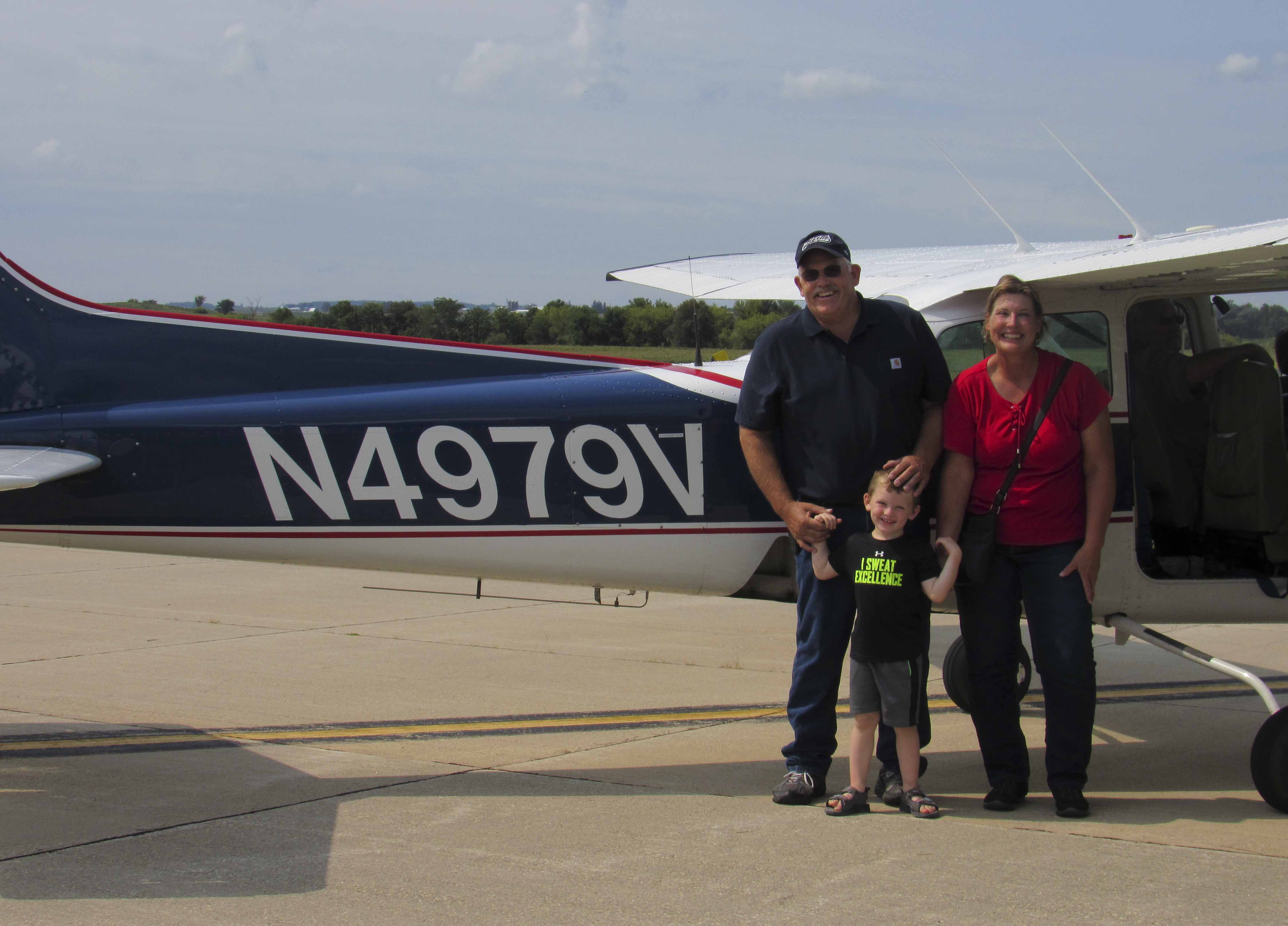 Dylan Keltner gets ready to take off on a plane ride with grandparents Brien and Lisa Keltner, all of Anamosa.