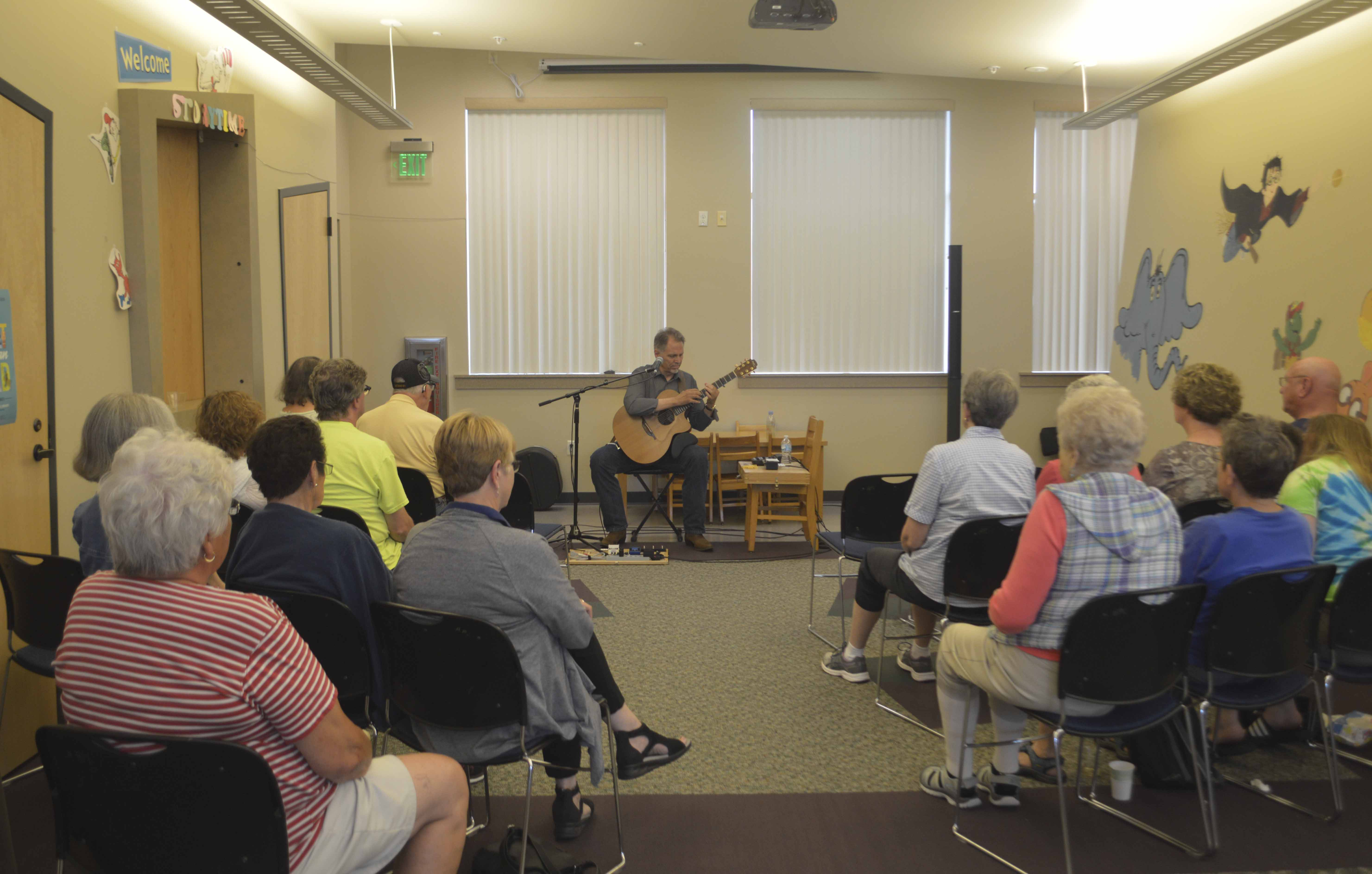On Thursday, June 28, Jerry Barlow performed at the Monticello Public Library. The concert, which was free to the public, drew in a crowd. (Photos by Hannah Gray)