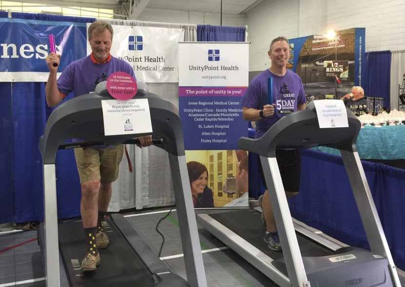 GJCF Manager John Harms and JRMC CEO Eric Briesemeister kick off the hospital's five-day marathon on July 19. Participants took turns walking/running for 15 minutes during the fair to rake in enough miles to equal a marathon (26). (Photo submitted)
