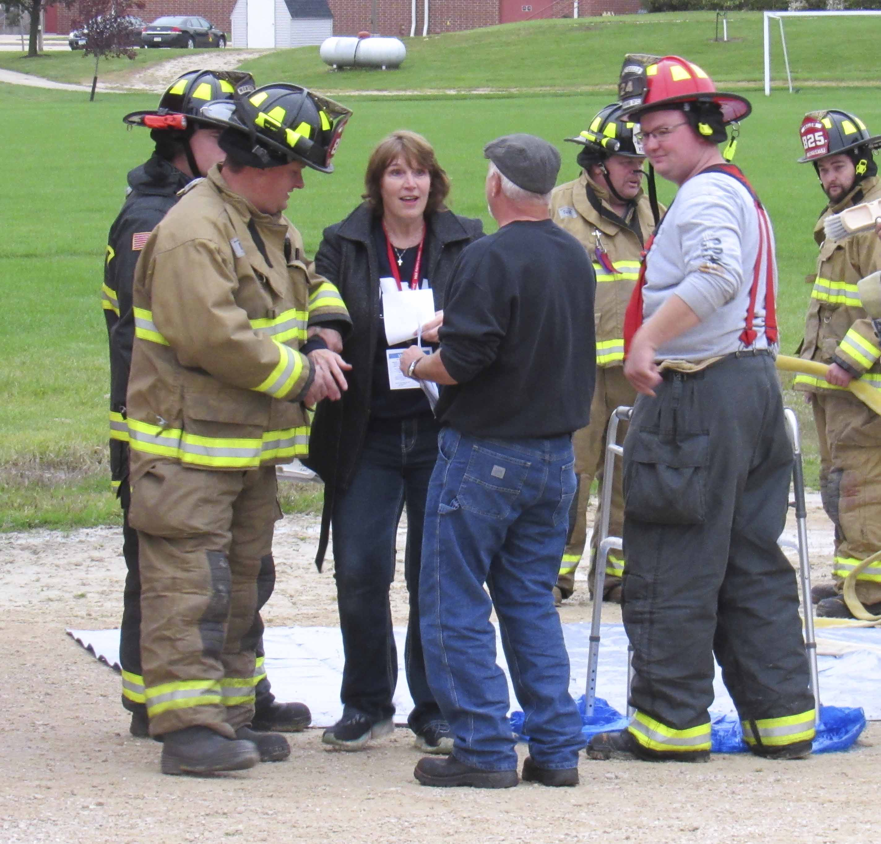 """Members of Jones County fire departments """"hose"""" off those who were exposed to the chemical spill before they are seen and assessed by medical staff. Carol Janssen of Monticello was one of those victims."""