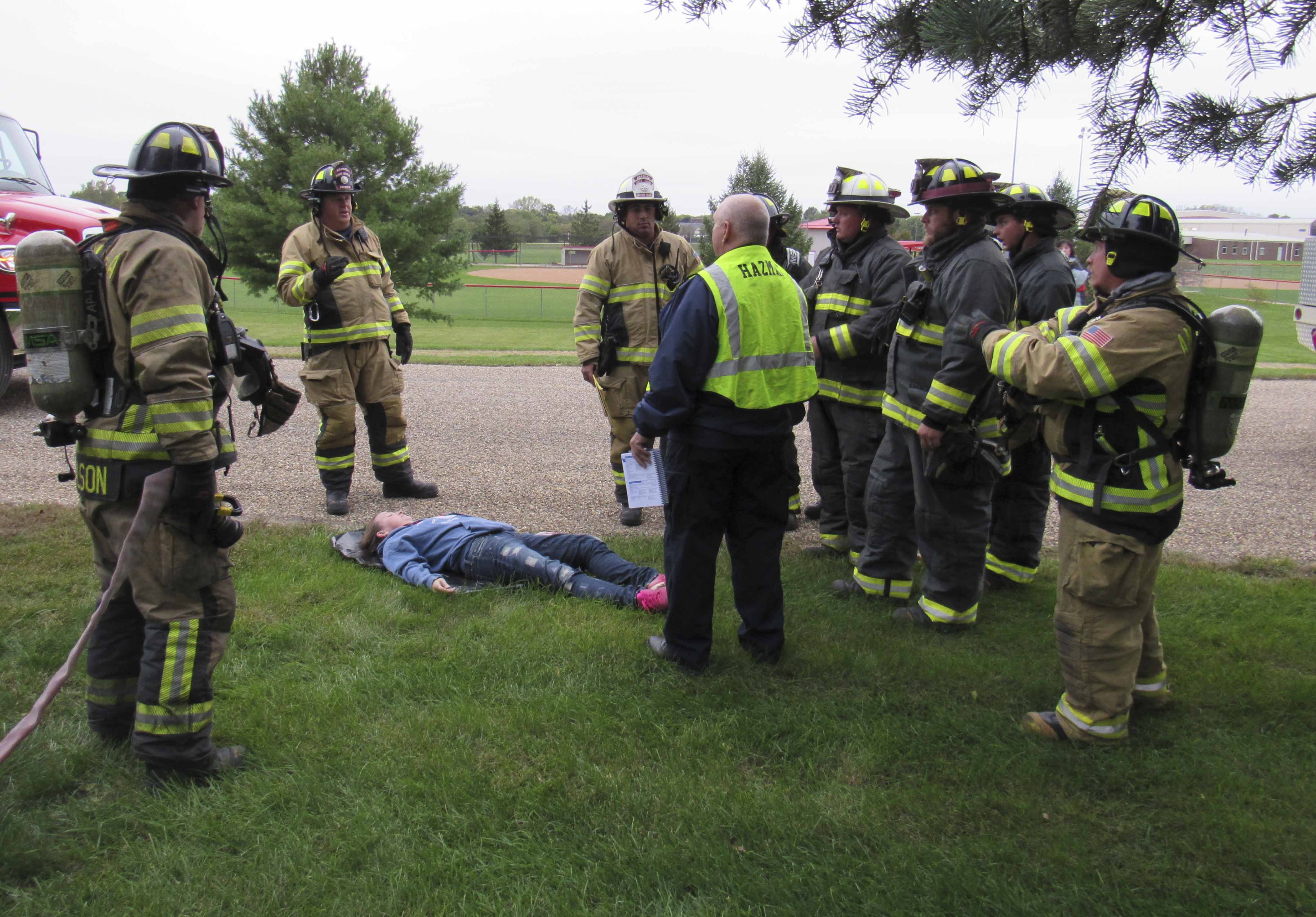 Linn County Hazmat personnel debriefed members of area fire departments as they assessed the situation involving a truck driver (Lisa Oswald) who fell victim to the chemical spill. Those agencies who took part in the hazmat training included: MFD, MPD, Monticello Ambulance, Emergency Management, AFD, Anamosa EMS, JRMC, Onslow Fire, Midland EMS, Jones County Dispatch, Linn County Hazmat, and medical examiners Dr. Michael Weston and Victoria Weston.