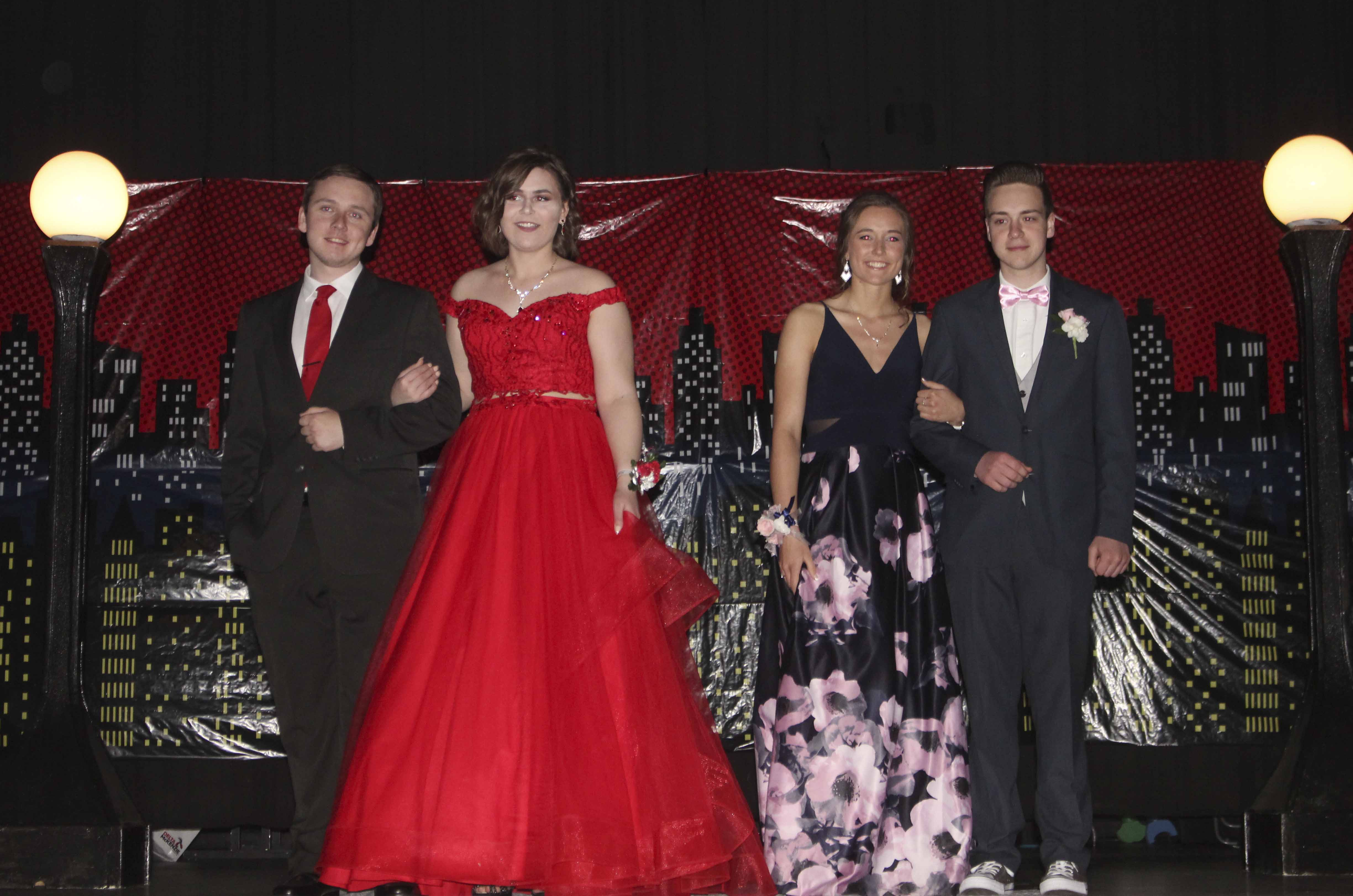 Enjoying their moment on stage are (from left) Quinn Fiedler, Cassie Gillmore, Jordyn Patterson and Nate Hawkins.