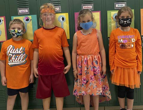 First graders at Shannon wore orange on Tuesday during Homecoming week for Color Day. From left are Morgan Motley, Jhett Jacobs, Laura Graham, and Abigael Patnode.