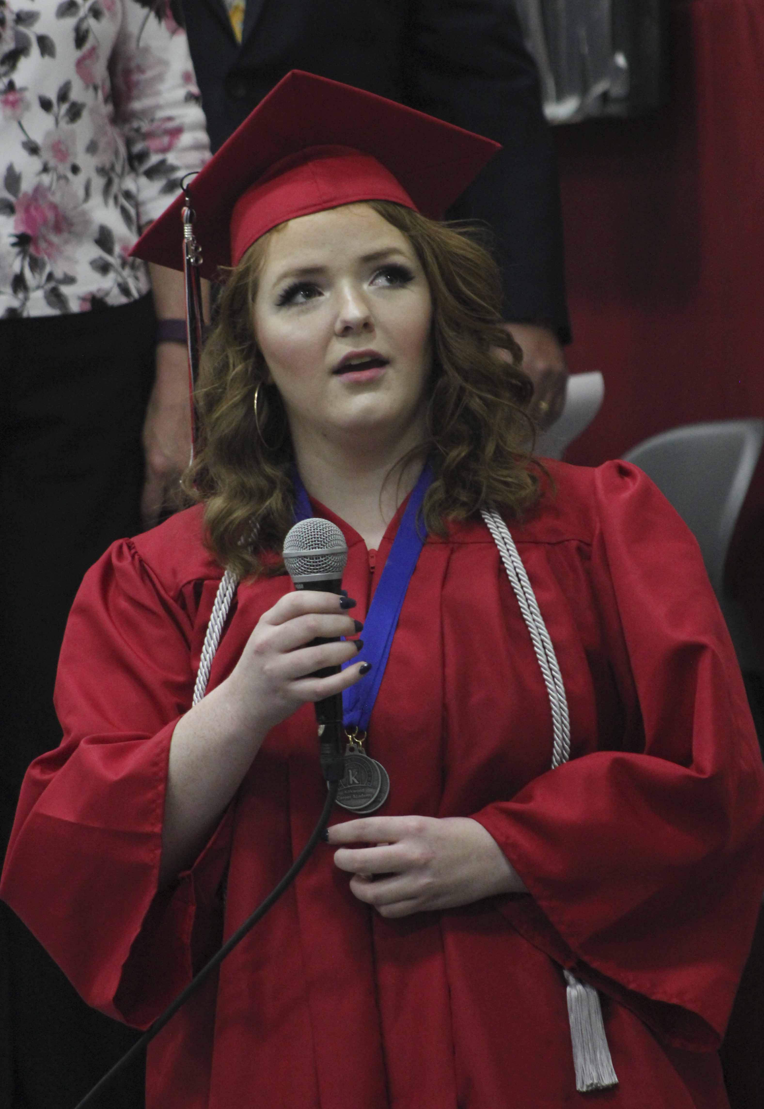 Graduate Kiley Wall sings the National Anthem.