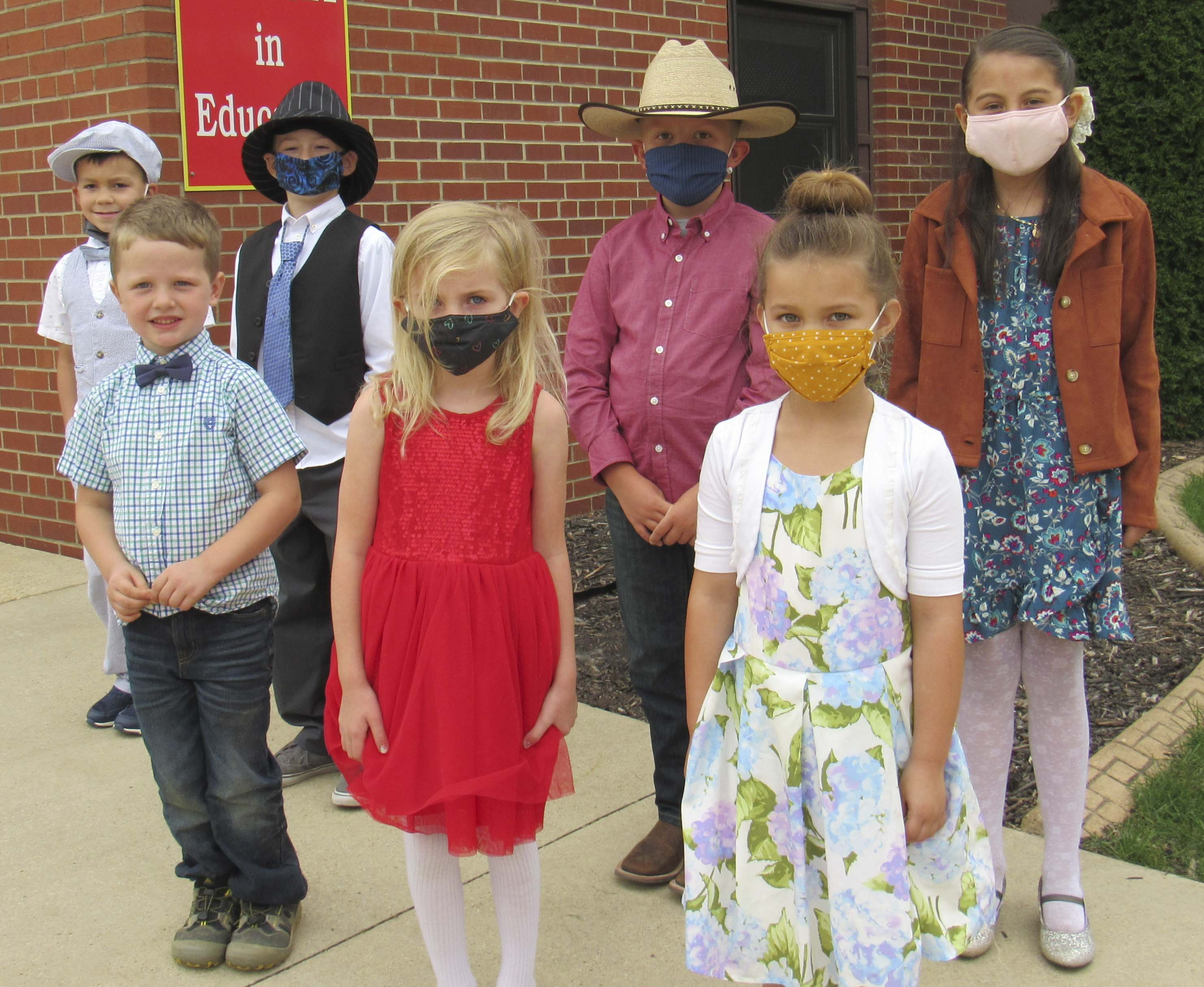 """Sacred Heart students """"Dressed for Success"""" on Thursday in their celebration of Homecoming. In front are Lincoln Grant, Millie Kremer, and Lia Mae Lyons. Back row, Davis Lyons, Elliot Chapman, Will Sperfslage, and Cynthia Fernandez."""