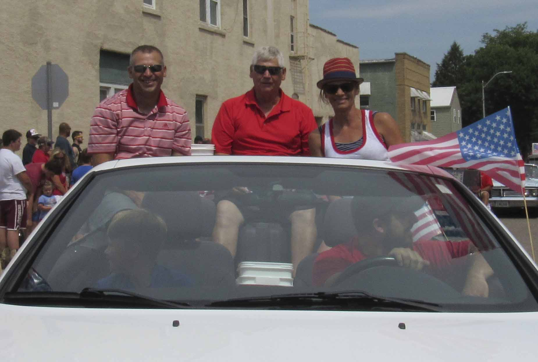 Scott Brighton, Roger Brighton and Becky (Brighton) Cooper were the grand marshals in Monticello's July 4 parade. They were honored for their service to the community. (Photo by Kim Brooks)