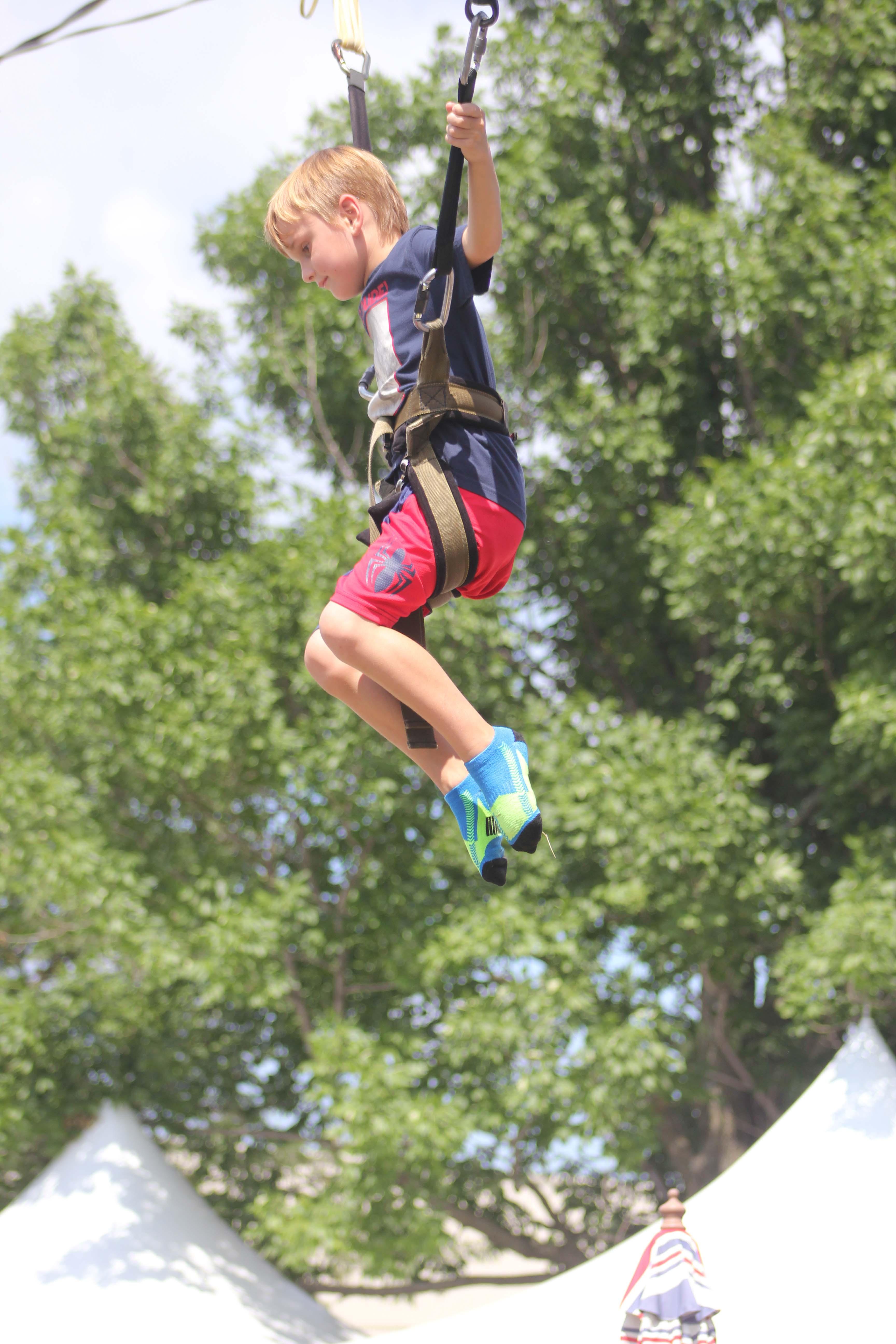 Gabe Hooten of Dallas, Tex. enjoys the bungee ride at the fair.