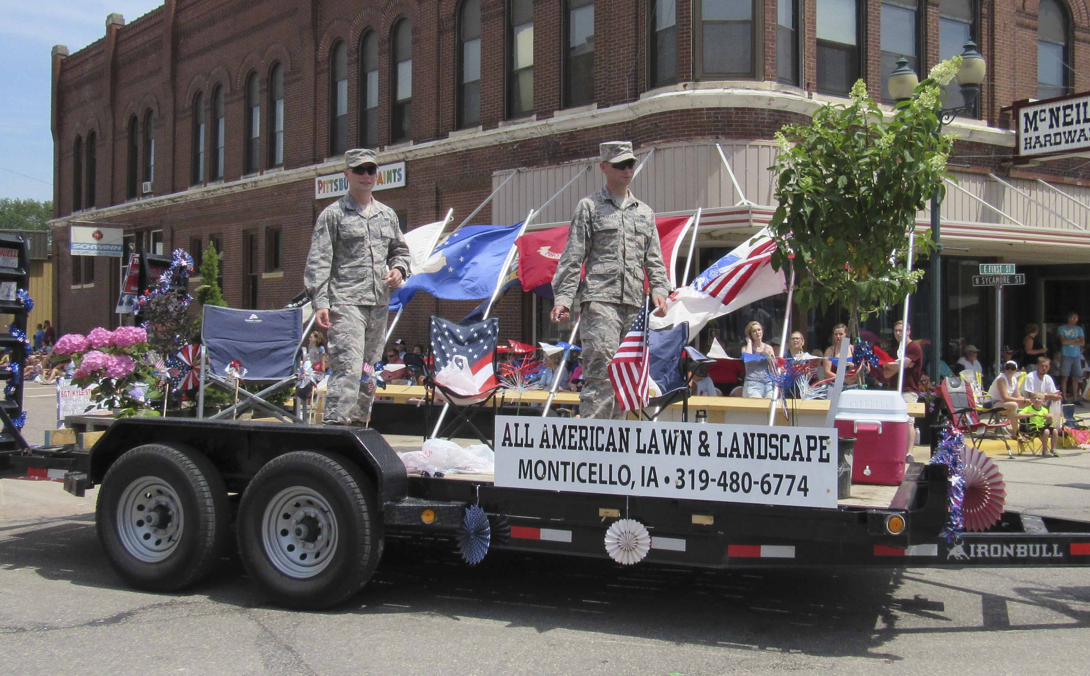 All American Lawn & Landscape owned by Kyle Stadtmueller, took home third place in the parade. Standing on the float are Stadtmueller's brothers Seth and Mitchell. (Photo by Kim Brooks)