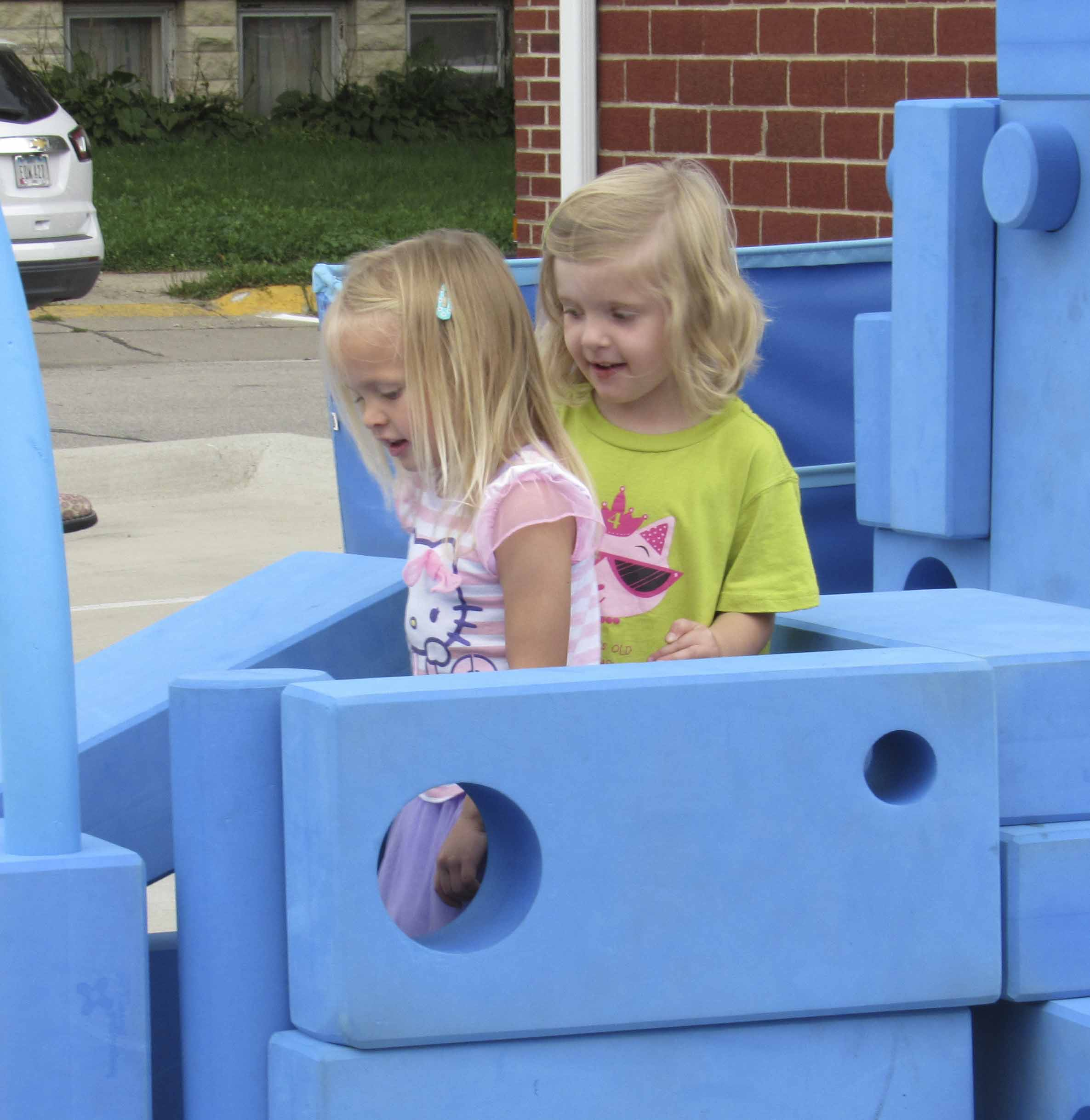 Avery Blakesley and Ivy Young had some fun playing with the giant foam blocks as part of Uptown Thursday Night. The blocks, as well as life-sized LEGOs were part of Kendall Hunt Publishing Company's Mobile Play Lab. Several local businesses helped sponsor the lab. (Photos by Kim Brooks)