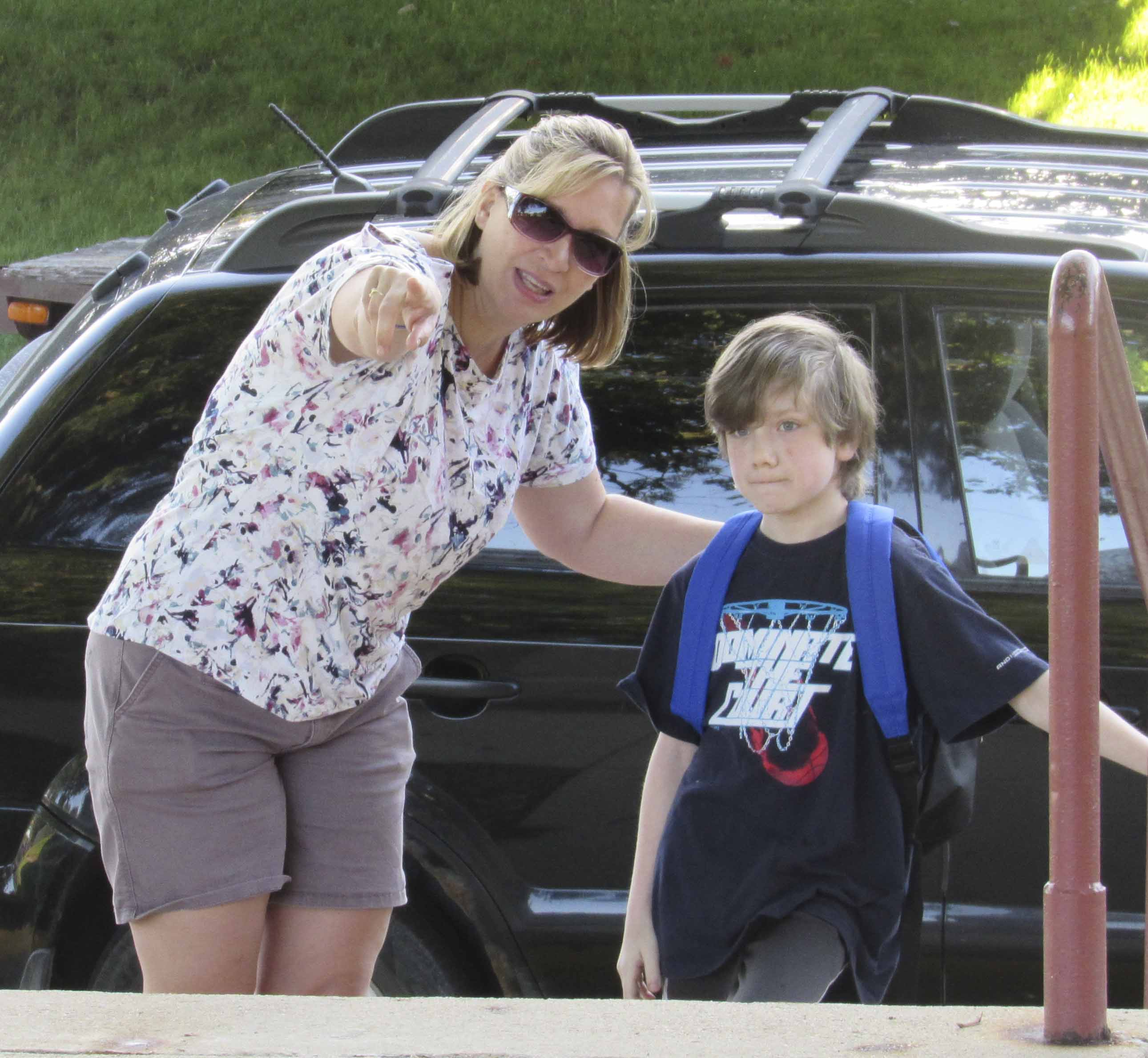 Carpenter Associate Traysa Orcutt directs new fourth grader Nickolas Bachelder to his line outside the school. (Photo by Kim Brooks)