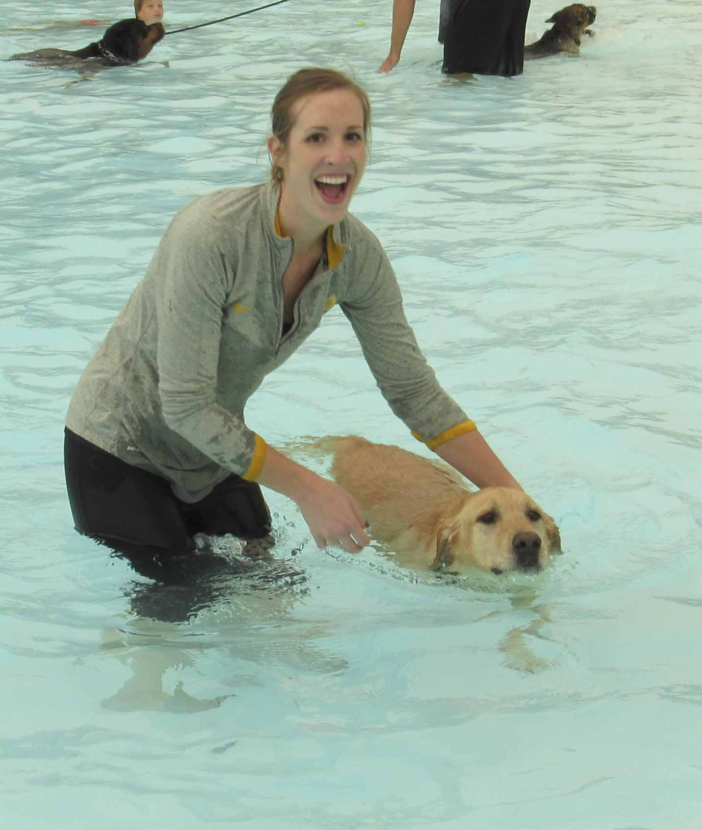 Caitlyn Miller of Monticello and her dog Jack enjoy a swim in the Monticello pool. (Photo by Kim Brooks)