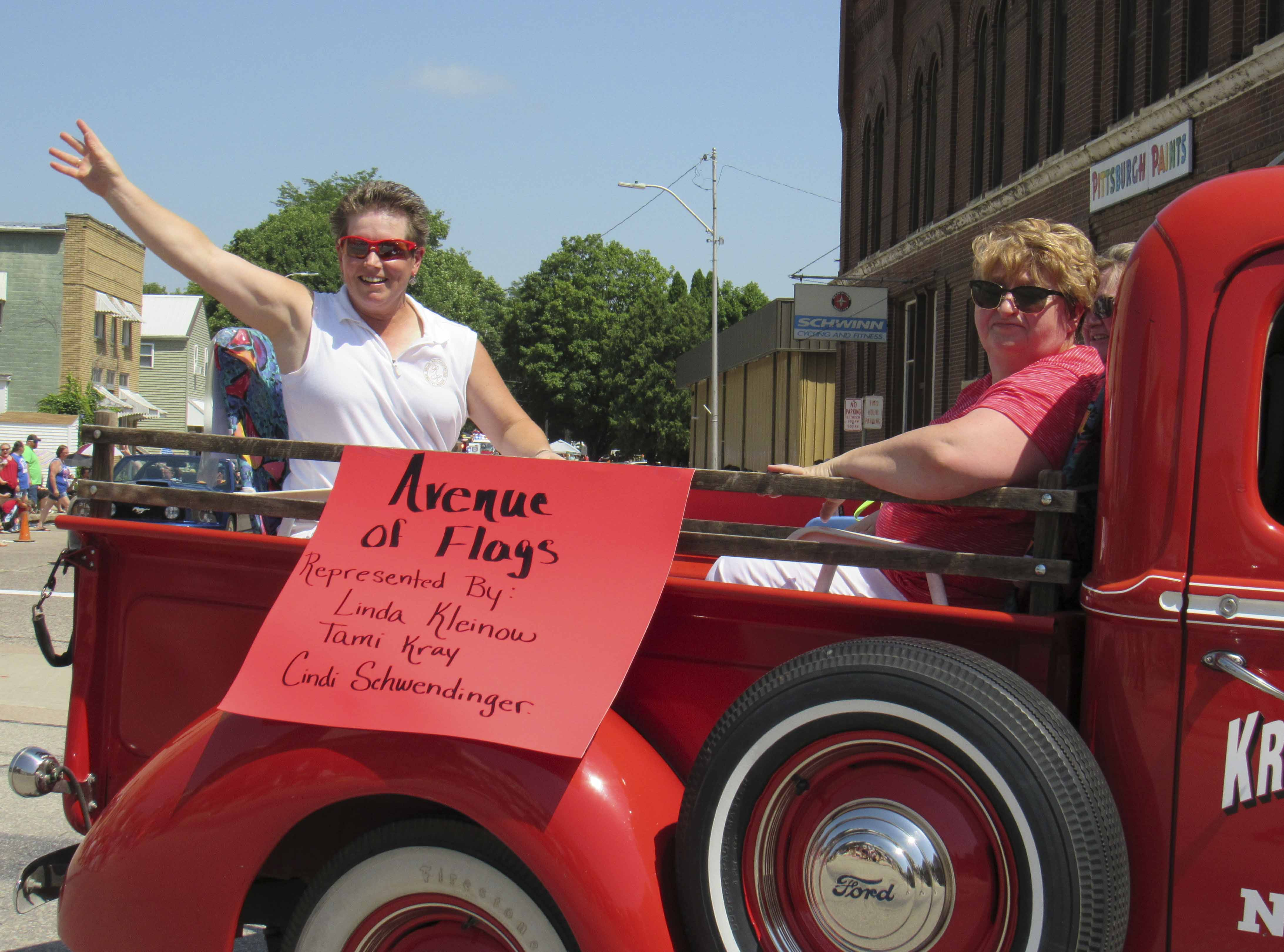One of this year's parade grand marshals included the Avenue of Flags, represented by Linda Kleinow, Tami Kray (not pictured) and Cindi Schwendinger.