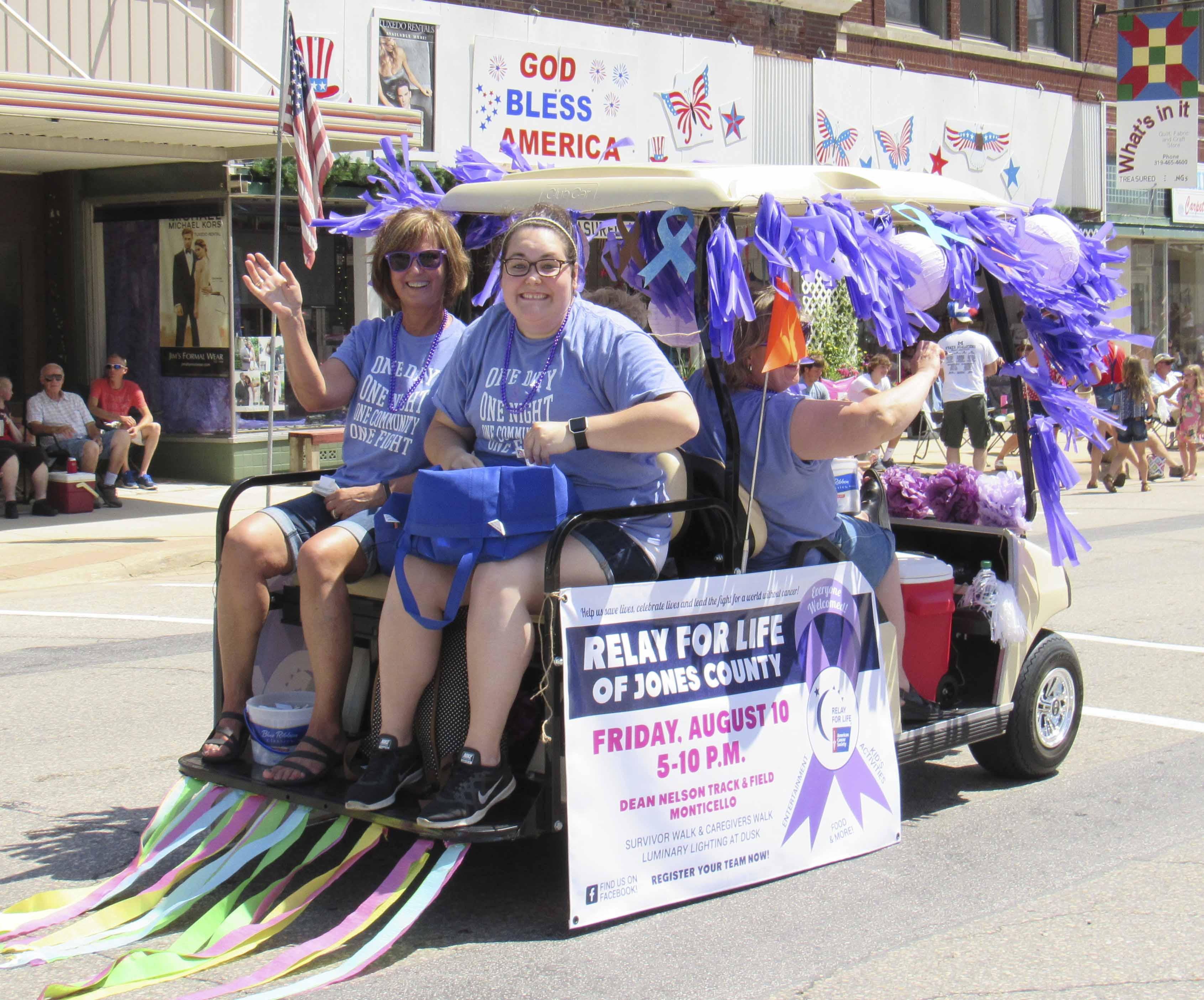 Helping to spread the word about the Aug. 10 Jones County Relay For Life in the parade were Sandy Moats and Abby Manternach. Not pictured were Kathy Bone and Mary Yanda.