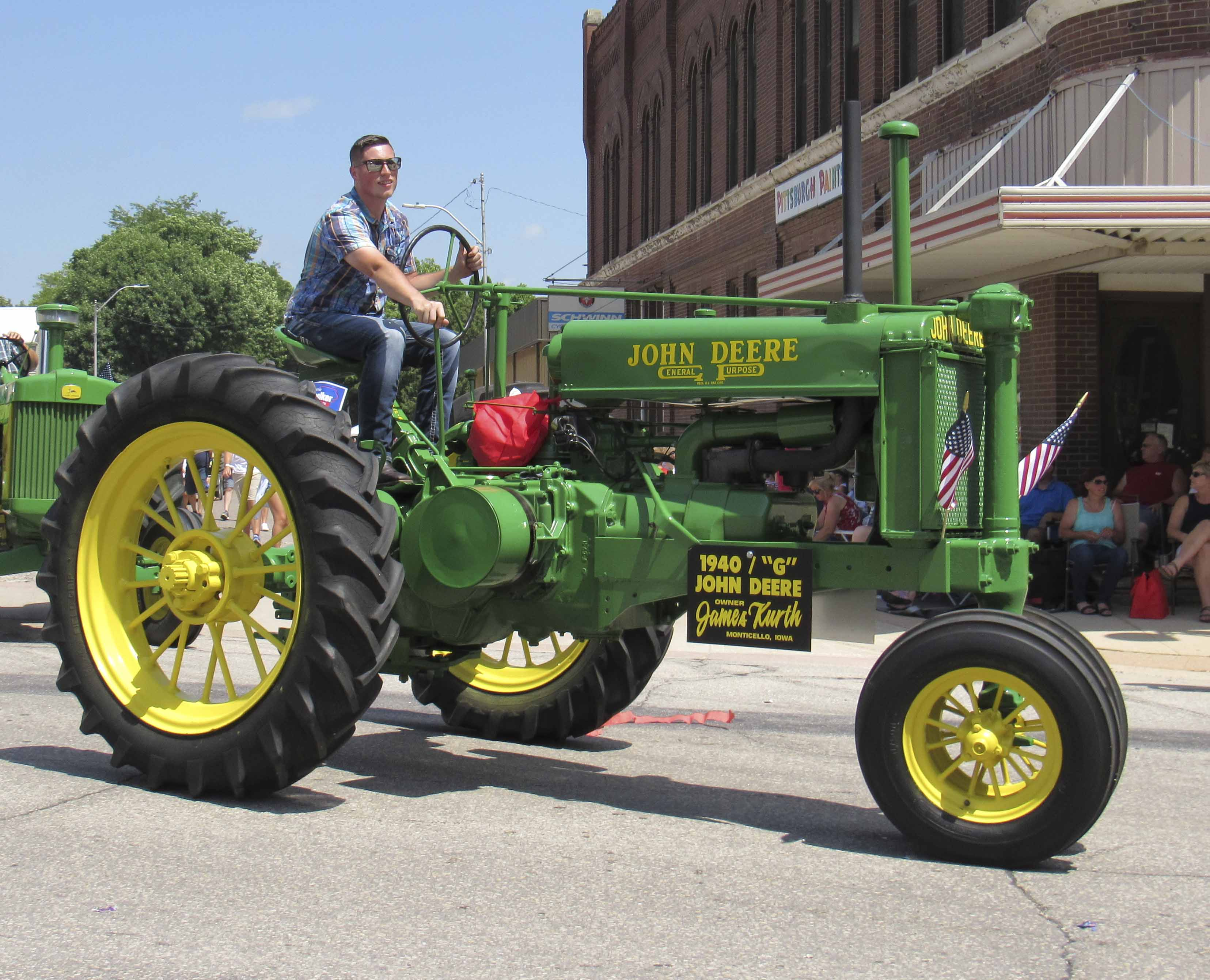 "Jordan Kurth drove a 1940 ""G"" John Deere tractor in the Monticello parade. The tractor is owned by James Kurth of Monticello."