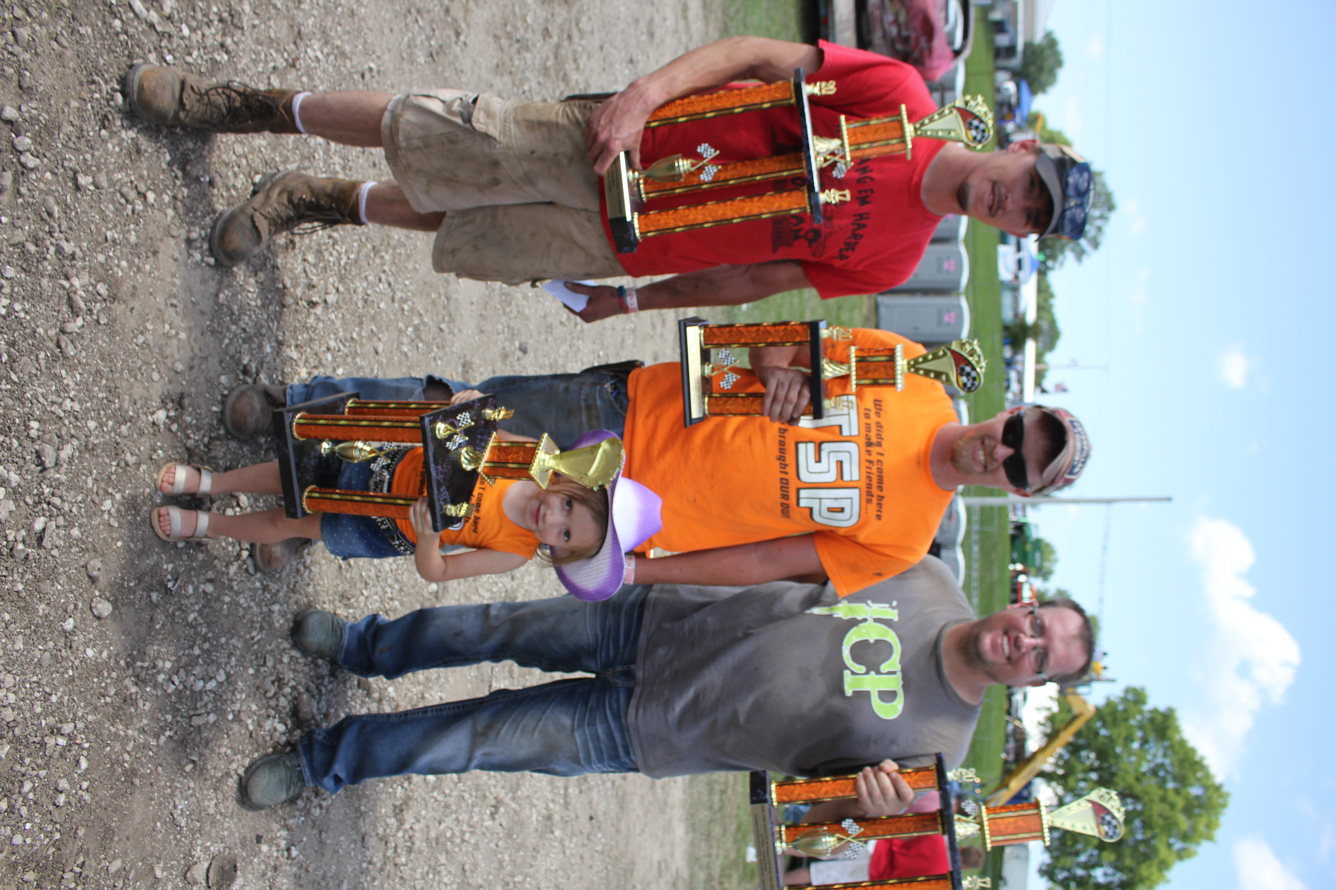 Winning the Football Demo were (from left) Nick Burgin and Josh Burgin of Edgewood, and Mitch Wendling of Manchester. In front is Josh's daughter Kendall.