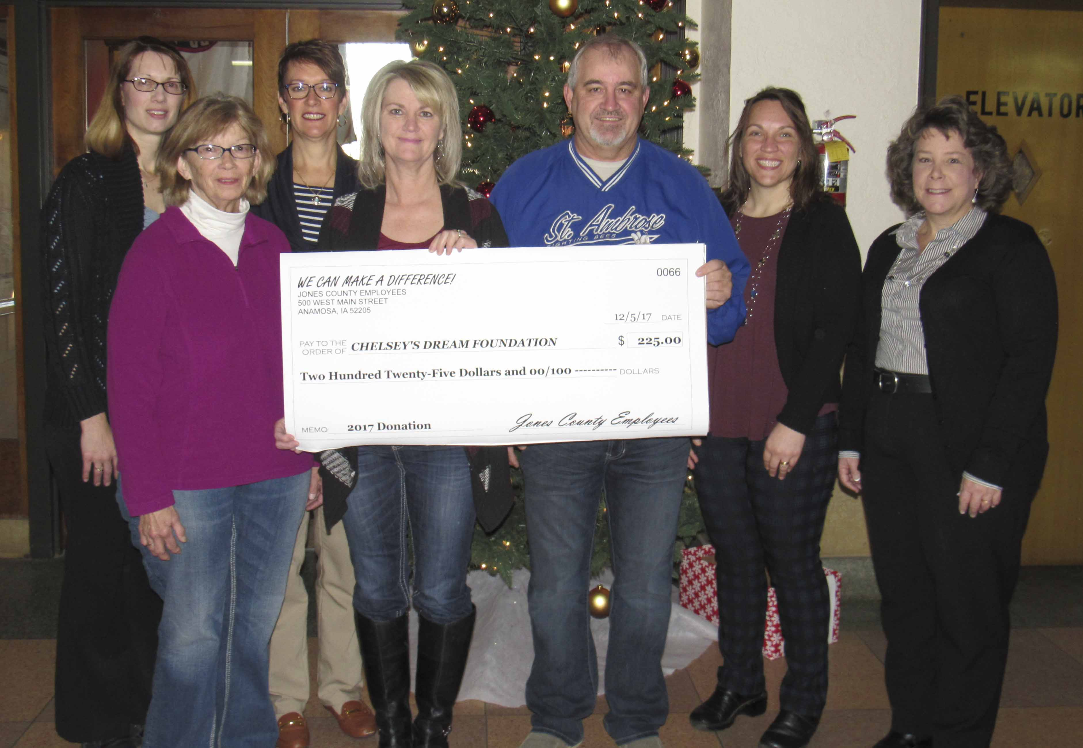 "Each year Jones County employees designate a portion of their paychecks toward worthy causes, a program called ""We Can Make a Difference."" One of their causes this year was Chelsey's Dream Foundation, receiving $225. Front from left are Karen Kiburz with JETS, Carol and Chuck Bildstein, Deputy Assessor Jane Russell, and Early Childhood Iowa Coordinator Sherri Hunt. Back row, Deputy Auditor Michele Lubben and Recorder Sheri Jones. (Photos by Kim Brooks)"