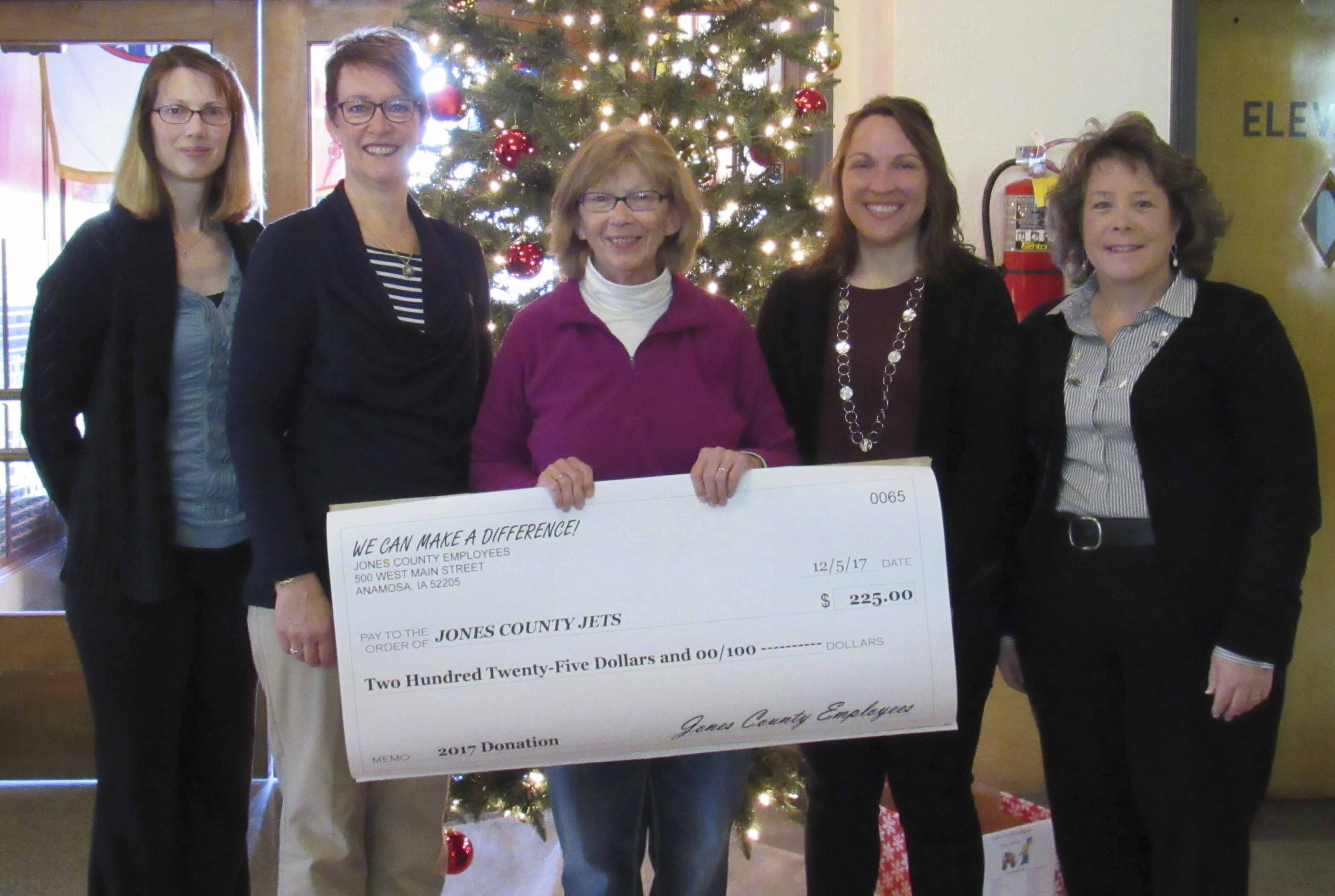 Karen Kiburz with JETS accepted a check for $225. From left are Deputy Auditor Michele Lubben, Recorder Sheri Jones, Kiburz, Deputy Assessor Jane Russell, and Early Childhood Iowa Coordinator Sherri Hunt.