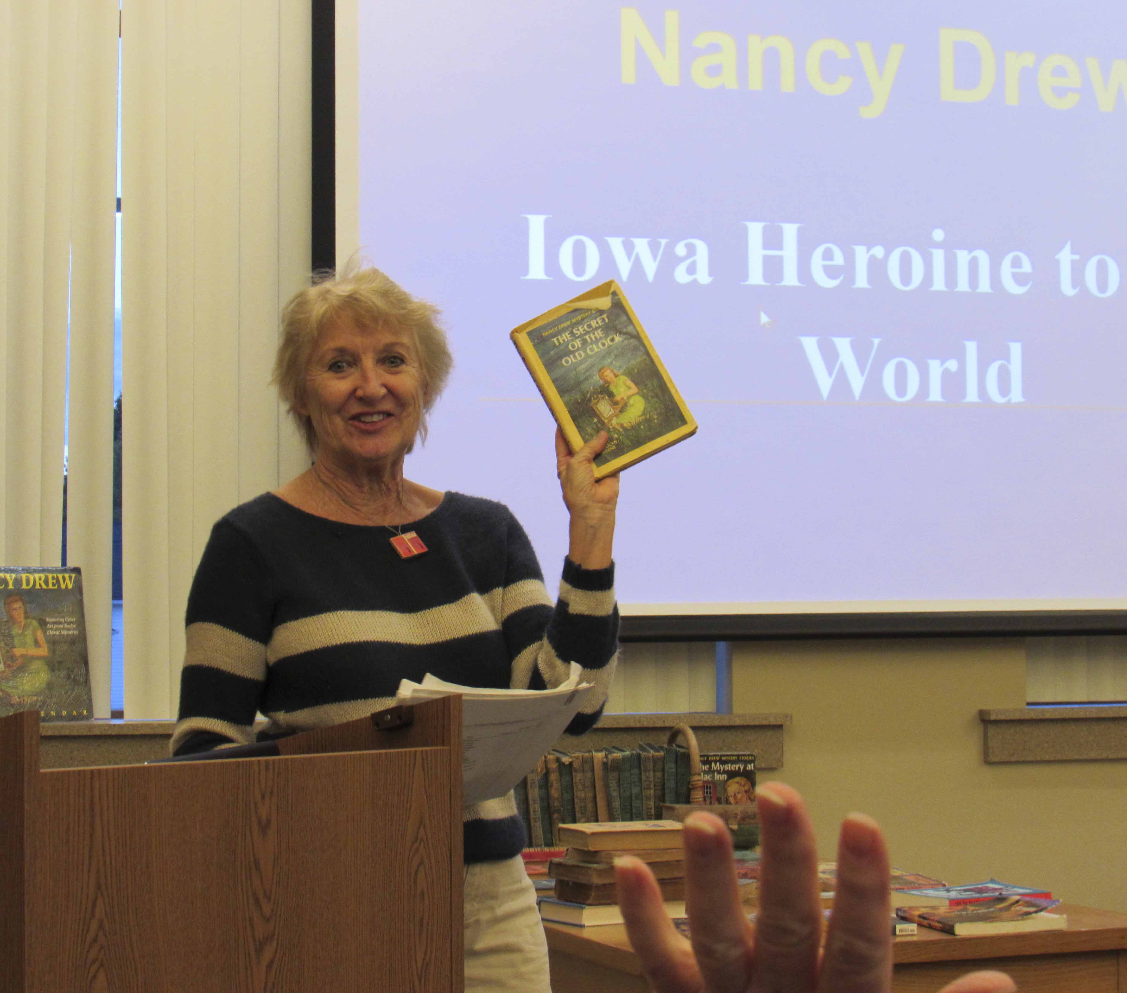 After collecting and researching Nancy Drew for more than 20 years, Lounsberry shared her rich wealth of knowledge with visitors at the Monticello library. She said Nancy Drew was the author's response to the Great Depression in the 1930s, assimilating Drew to that of Robin Hood who helped the less fortunate. Lounsberry said Nancy Drew had many of the qualities people look for in Midwesterns: charm, smarts, and outdoorsy. (Photos by Kim Brooks)
