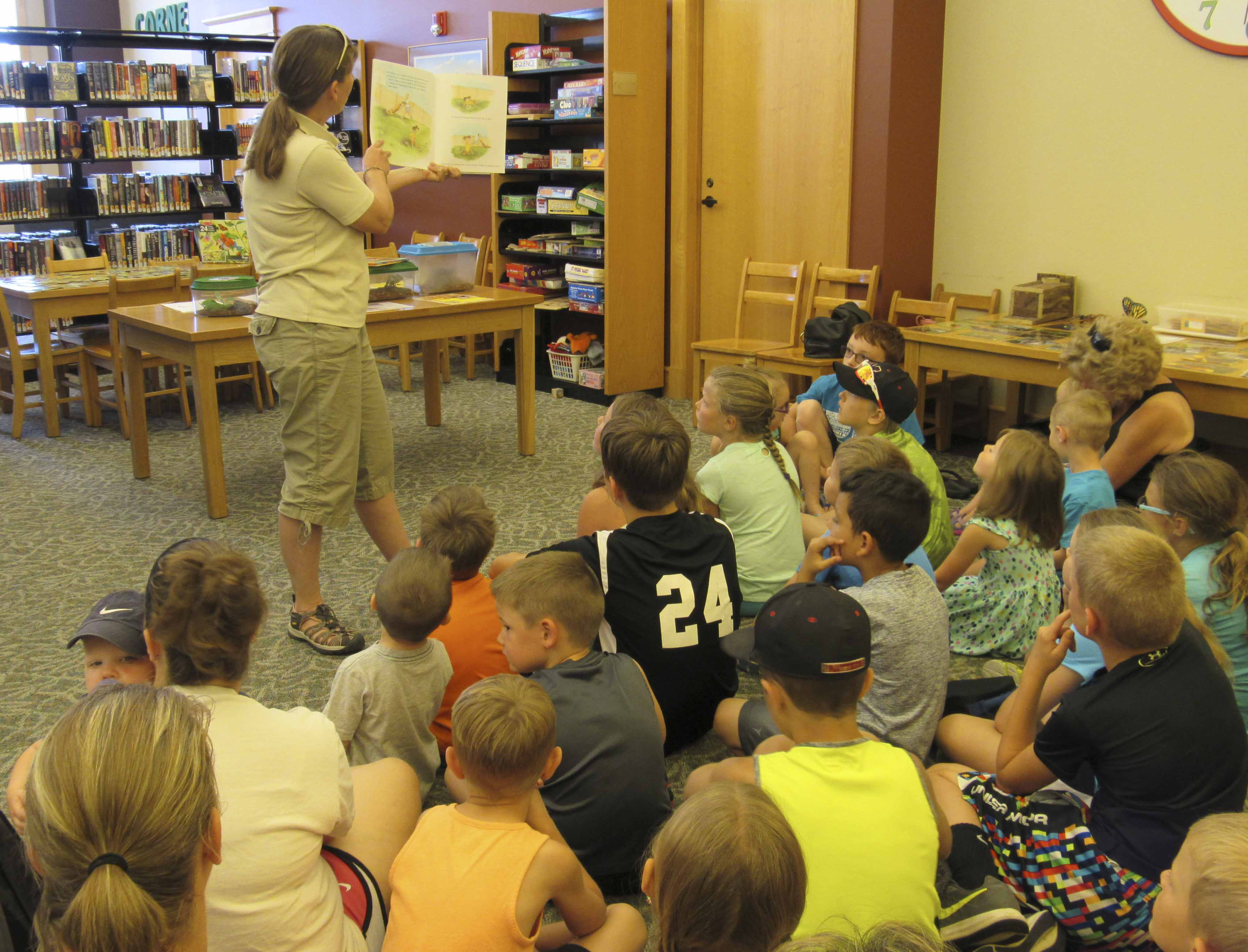 """Jones County Naturalist Michele Olson reads """"On Meadowview Street"""" by Henry Cole to dozens and dozens of youngsters at the Monticello library. Olson's visit was part of the library's Summer Reading Program. (Photos by Kim Brooks)"""
