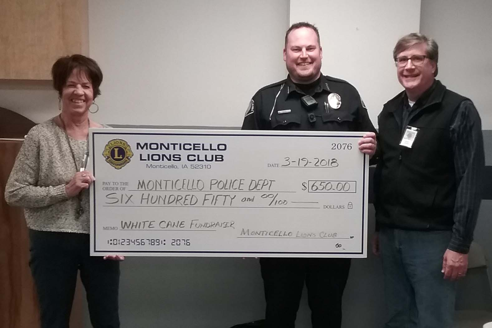 The Monticello Lions Club donated $650 from their White Cane fundraiser to the Monticello Police Department. From left are Astrid Smith, Police Chief Britt Smith and Pastor Wade Reddy. The White Cane fundraiser was organized by Pastor Reddy.