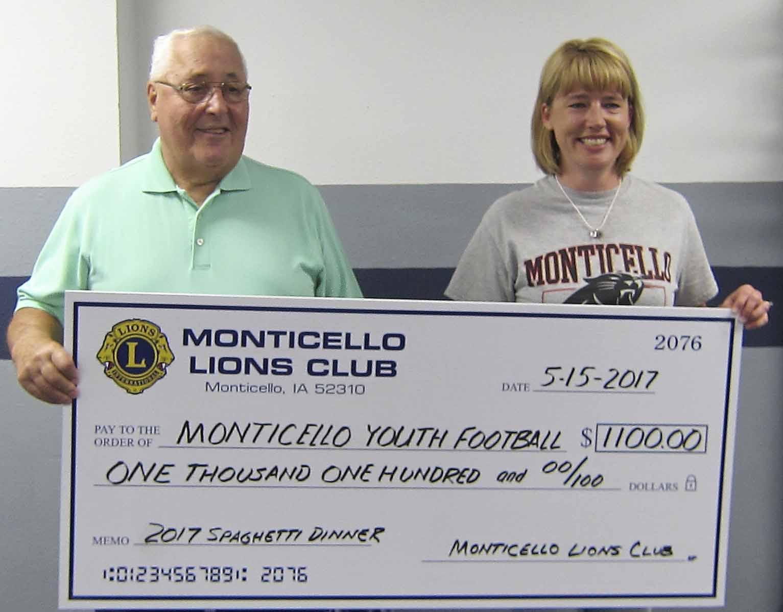 Lion Fred Williams presents Carrie Yates, Monticello Youth Football coordinator, with the MYF share of the 2017 Lions Spaghetti Dinner. The check was part of the proceeds from the April 27 Spaghetti Dinner held by the Monticello Lions Club with the assistance of the MYF players and parents. (Photo submitted)