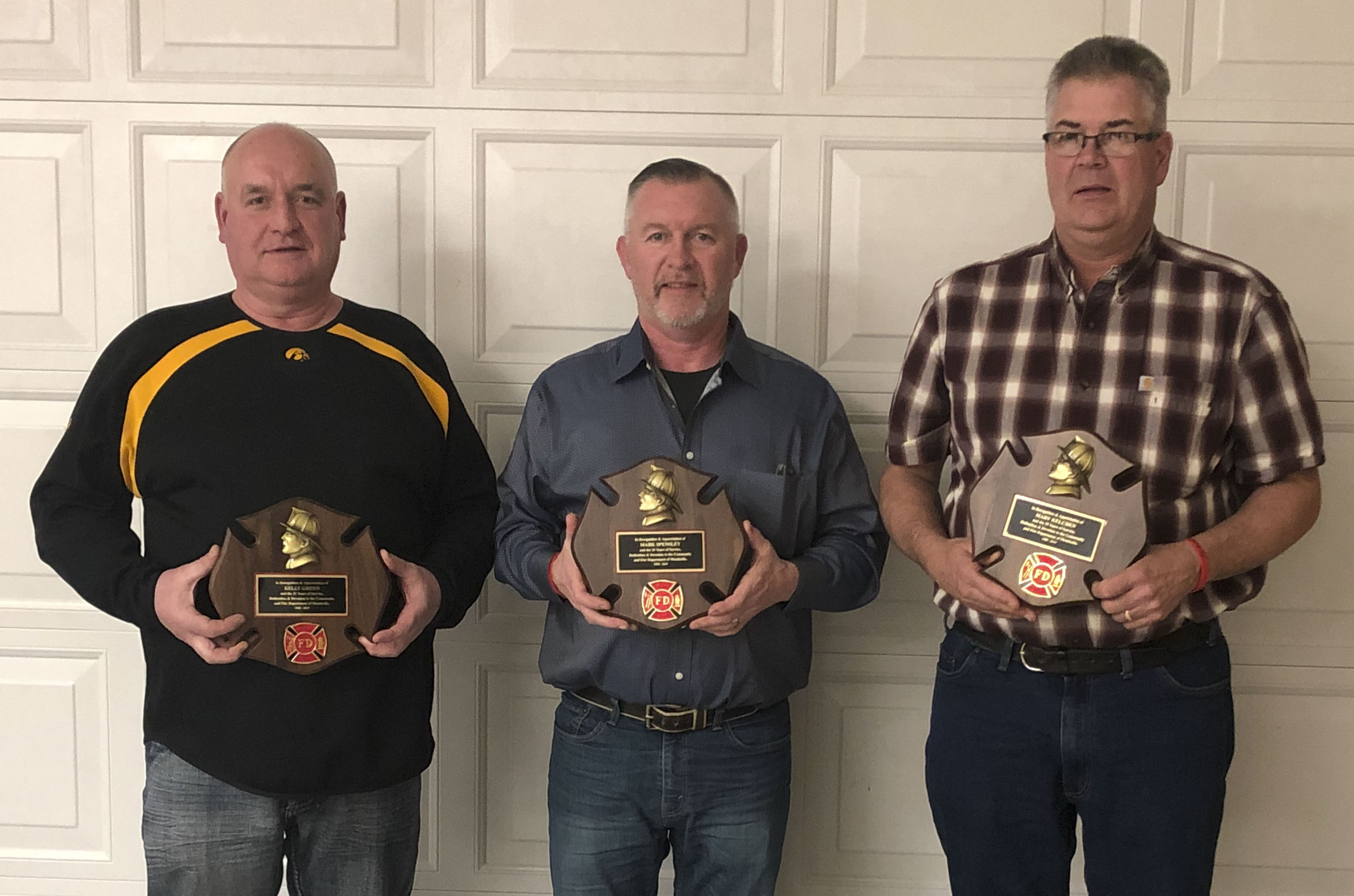 The Monticello Fire Department held their annual awards banquet on Feb. 8. Three retired firefighters were honored for their dedication to the department and community. From left are Kelly Green, 31 years, Mark Spensley, 26 years, and Marv Kelchen, 35 years. Missing from photo: Drew Mescher, 15 years.
