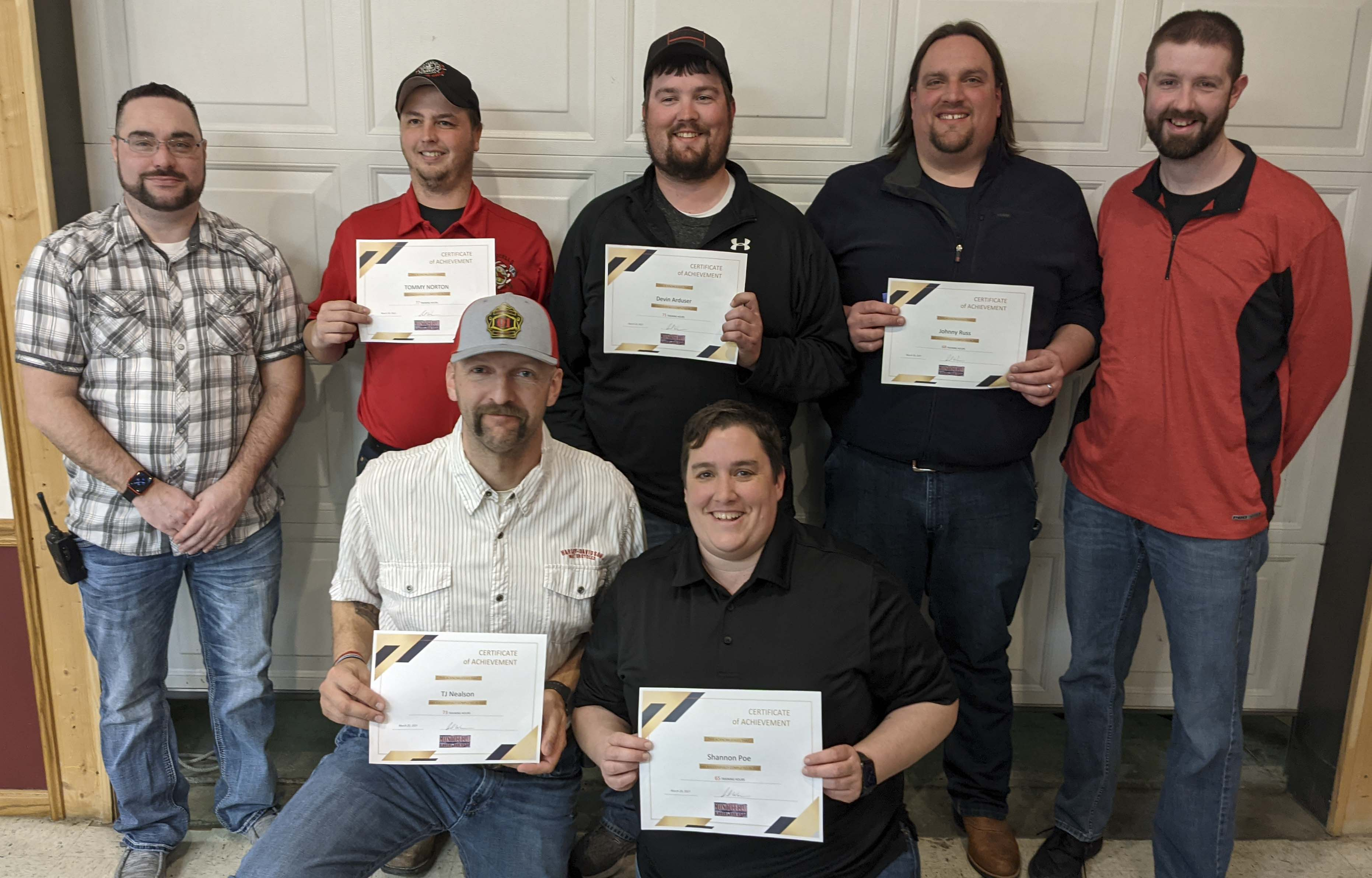 Several MFD members were recognized for their training efforts. Kneeling in front are TJ Nealson and Shannon Poe. Standing are Training Officer Paul Warner, Tommy Norton, Devin Arduser, Johnny Russ, and Assistant Training Officer David Husmann.