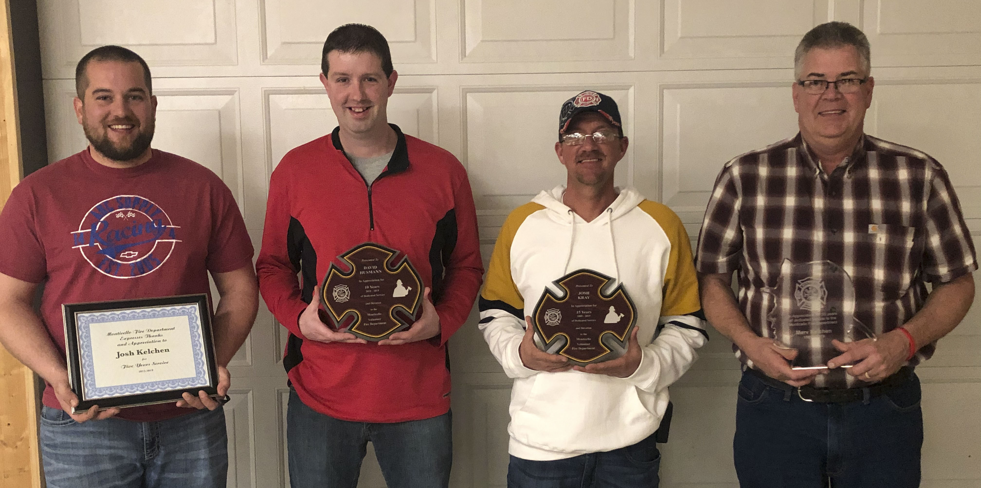 Four firefighters received awards for their years of service to the department. From left are Josh Kelchen, five years; David Husmann, 10 years; Josh Kray, 15 years; and Marv Kelchen, 35 years.