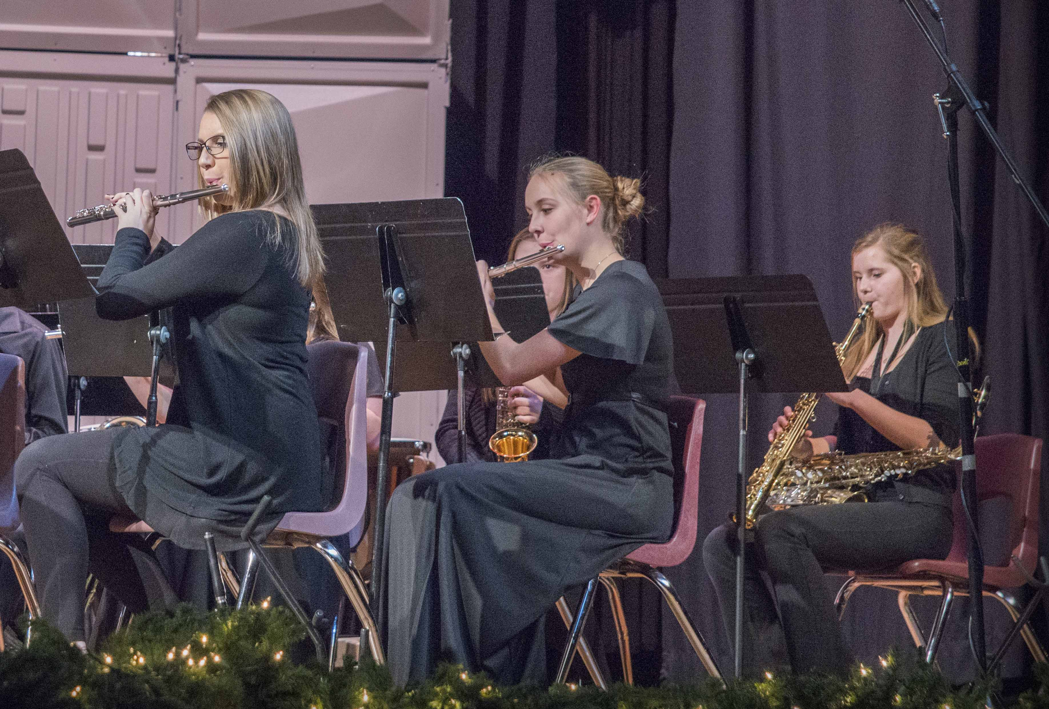 Performing during the MHS Band's Dec. 20 Holiday Concert are Abby Beem and Rachel Larabee on the flute, and Sophie Ahlrichs on alto saxophone.