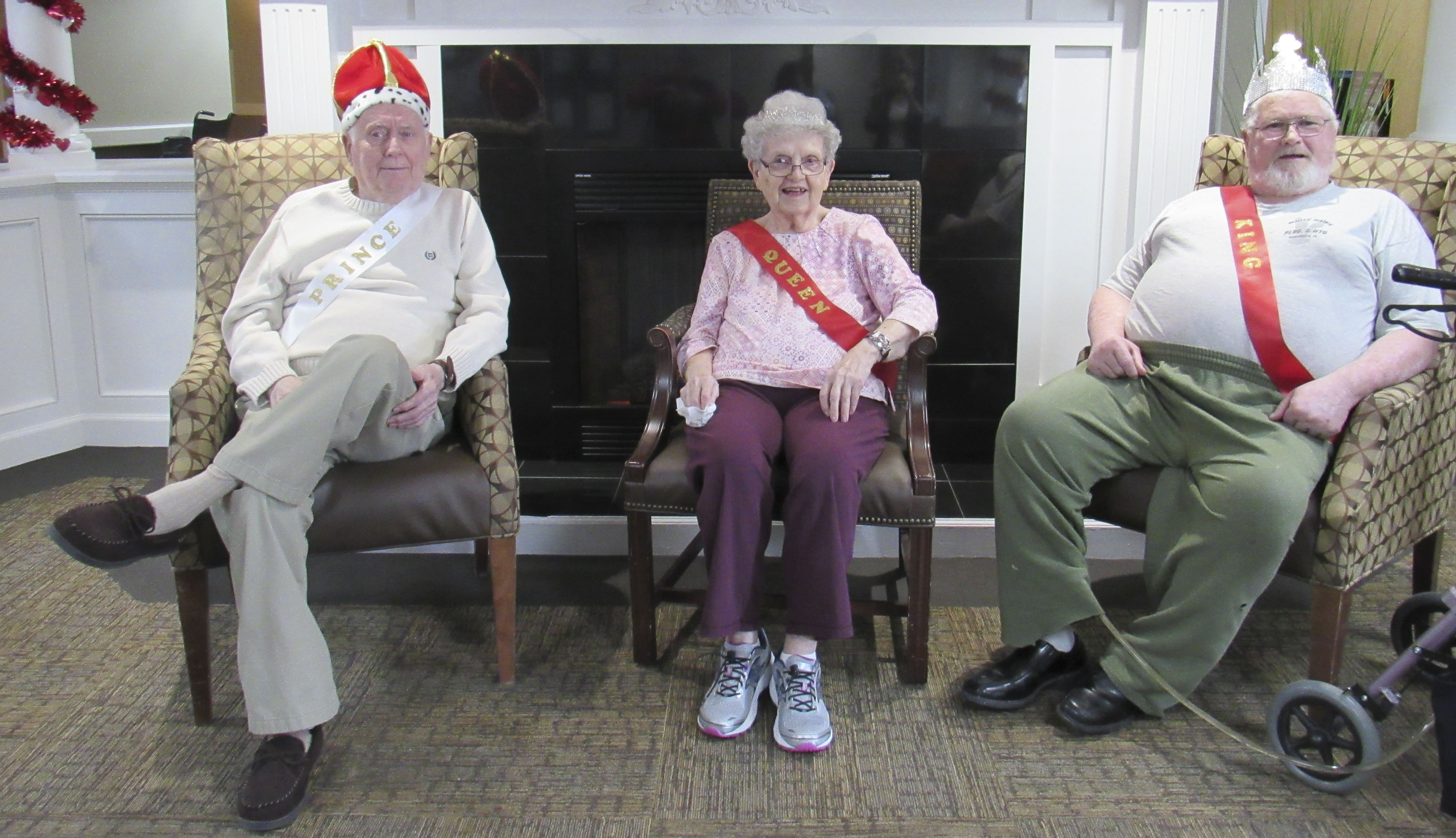 Every Valentine's Day, Monticello Nursing and Rehab Center crowns royalty among the residents. From left are Prince John Bell, Queen Norma McDonell, and King John White. Not pictured is Princess Marie Bartels. (Photo by Kim Brooks)