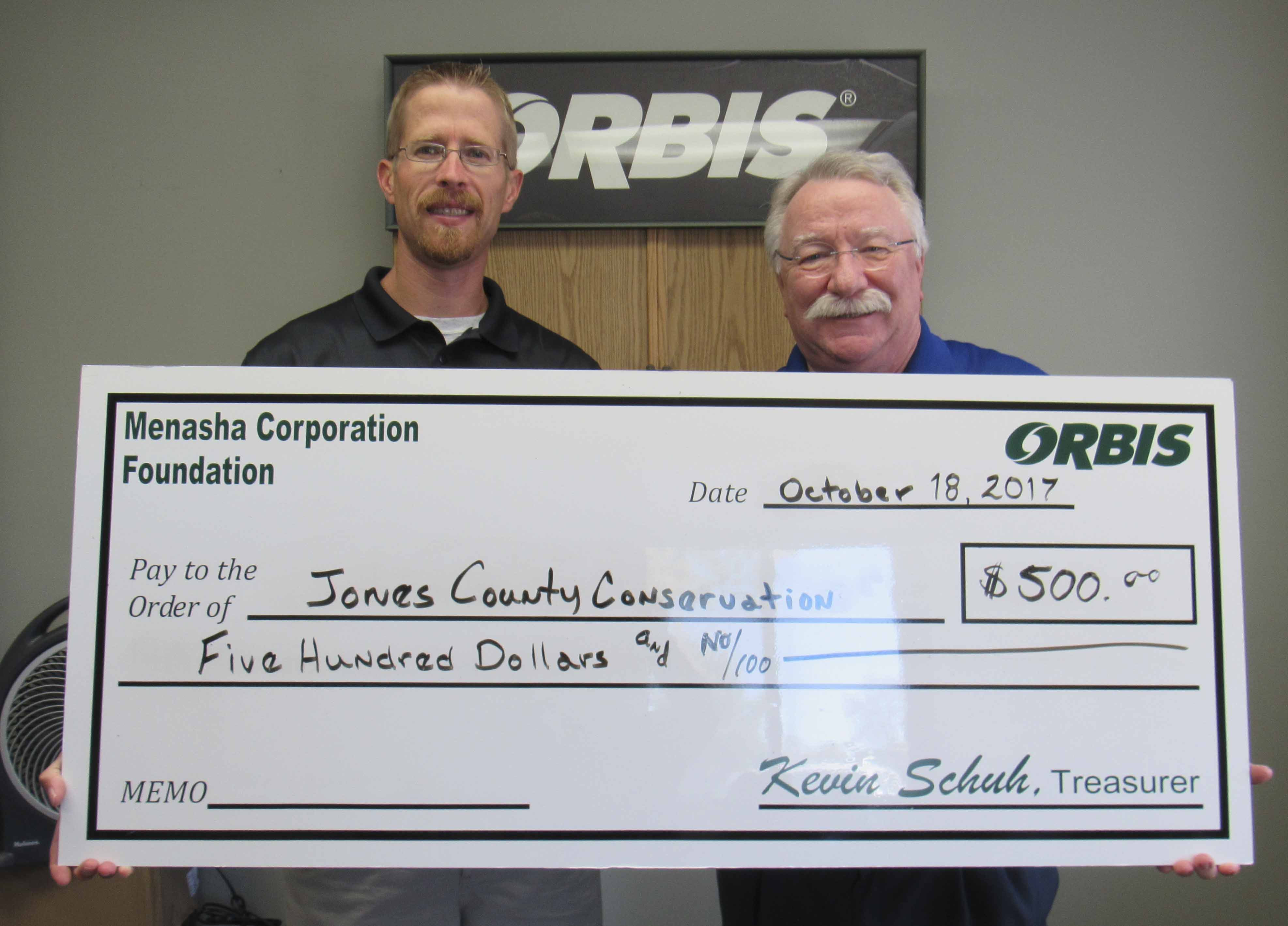Brad Mormann, Jones County Conservation Director, accepts a check from Richard Talcott on behalf of Orbis. (Photo by Kim Brooks)