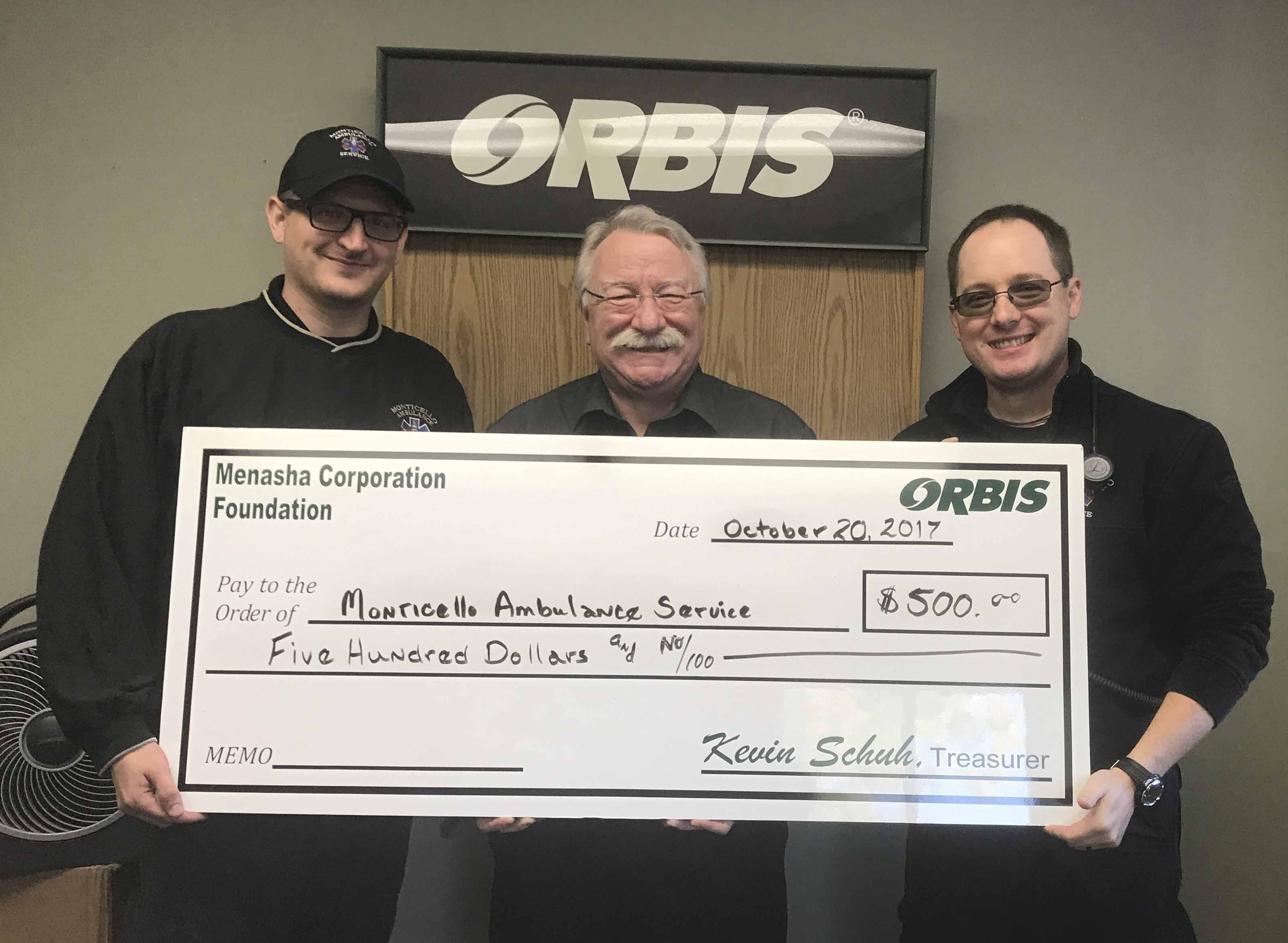 Orbis donated funds to the Monticello Ambulance Service. From left are Brandon Kent, Richard Talcott with Orbis, and Chris Ward. (Photo by Mary Yanda)